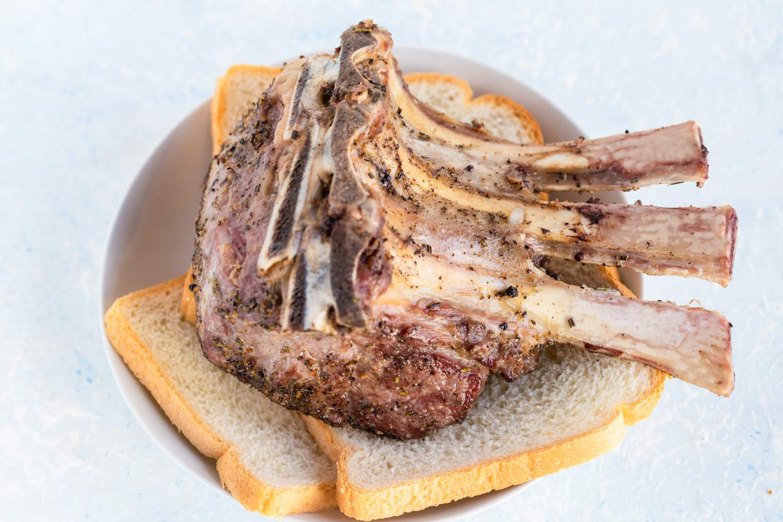 Prime rib draining on sliced bread