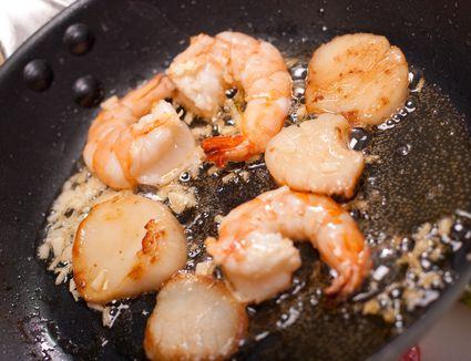 shrimp and scallops in pan