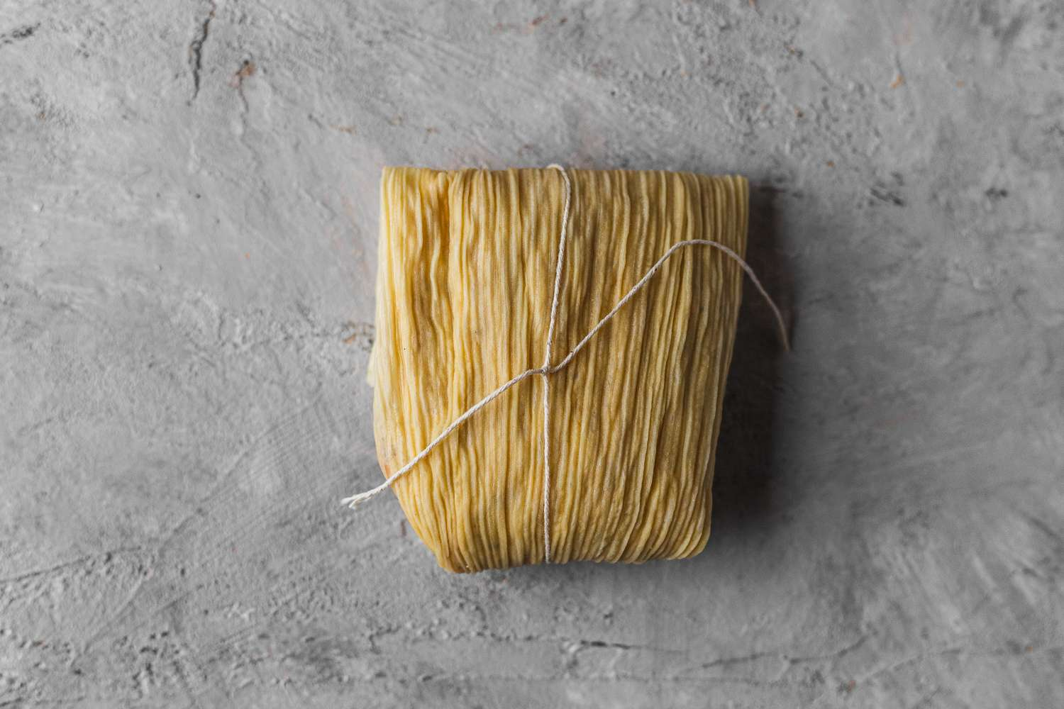 tamale wrapped and tied with a string