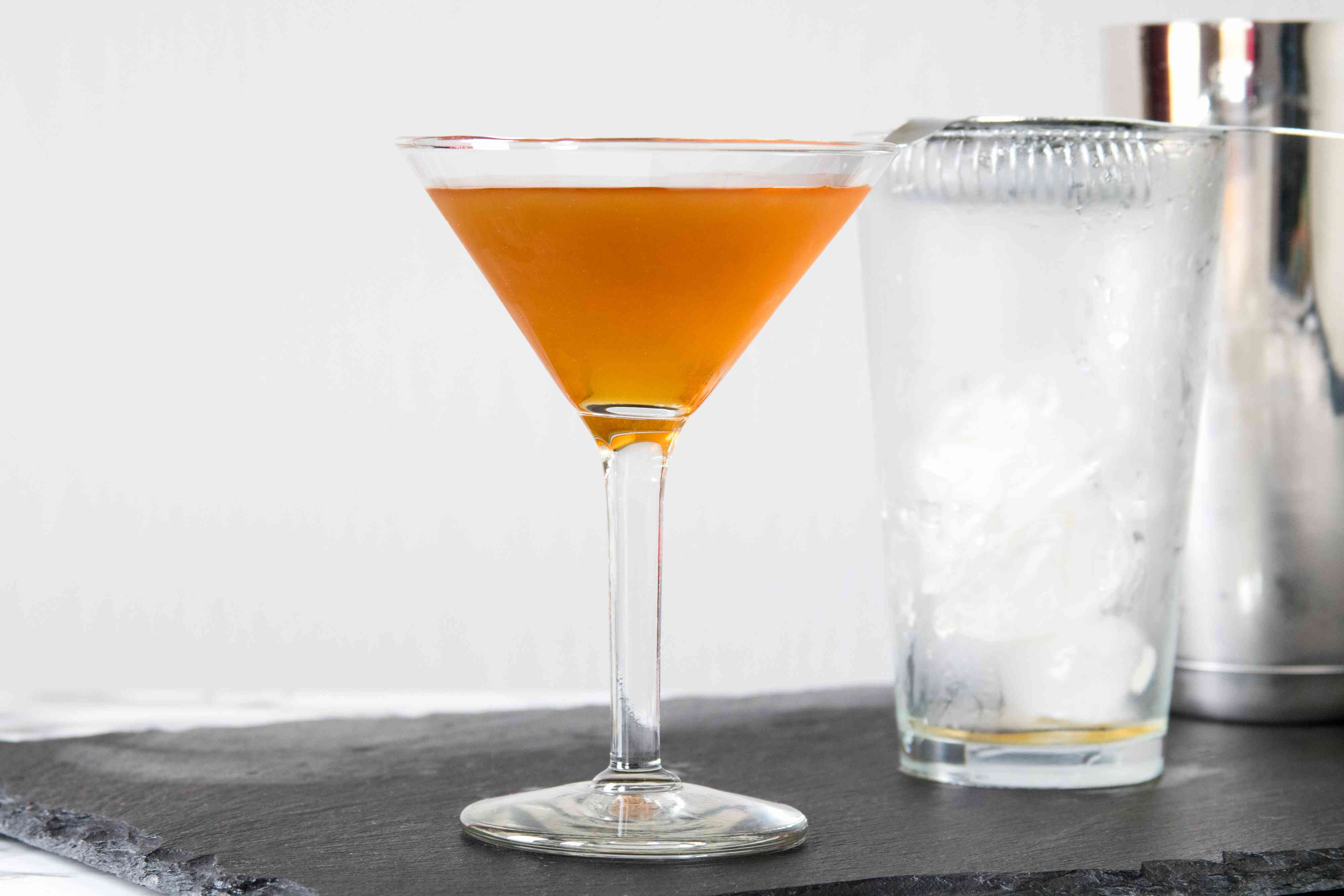 Straining a Classic Brandy Metropolitan Cocktail