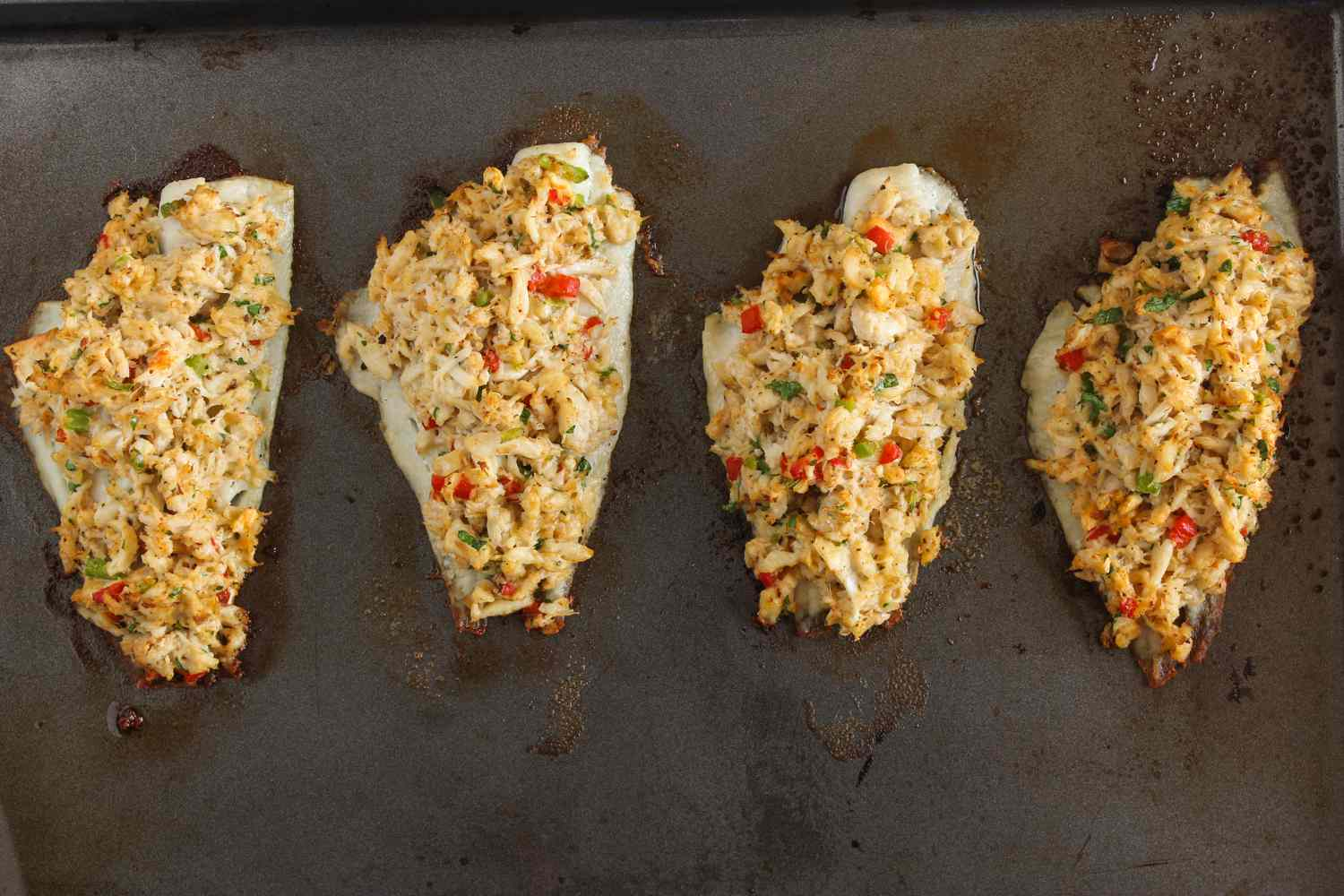 Stuffed flounder with crabmeat baking on pan