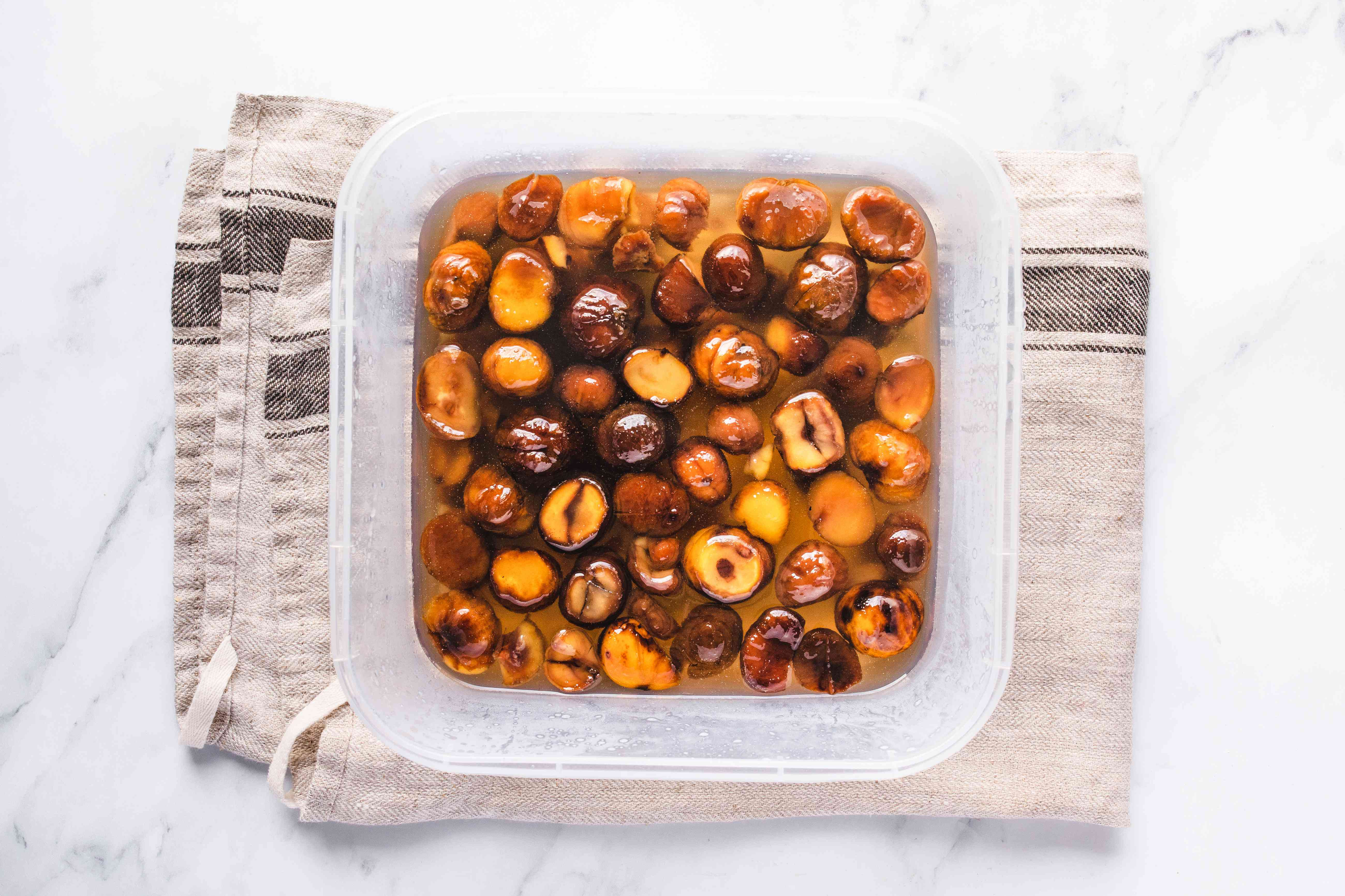 Chestnuts in container soaking