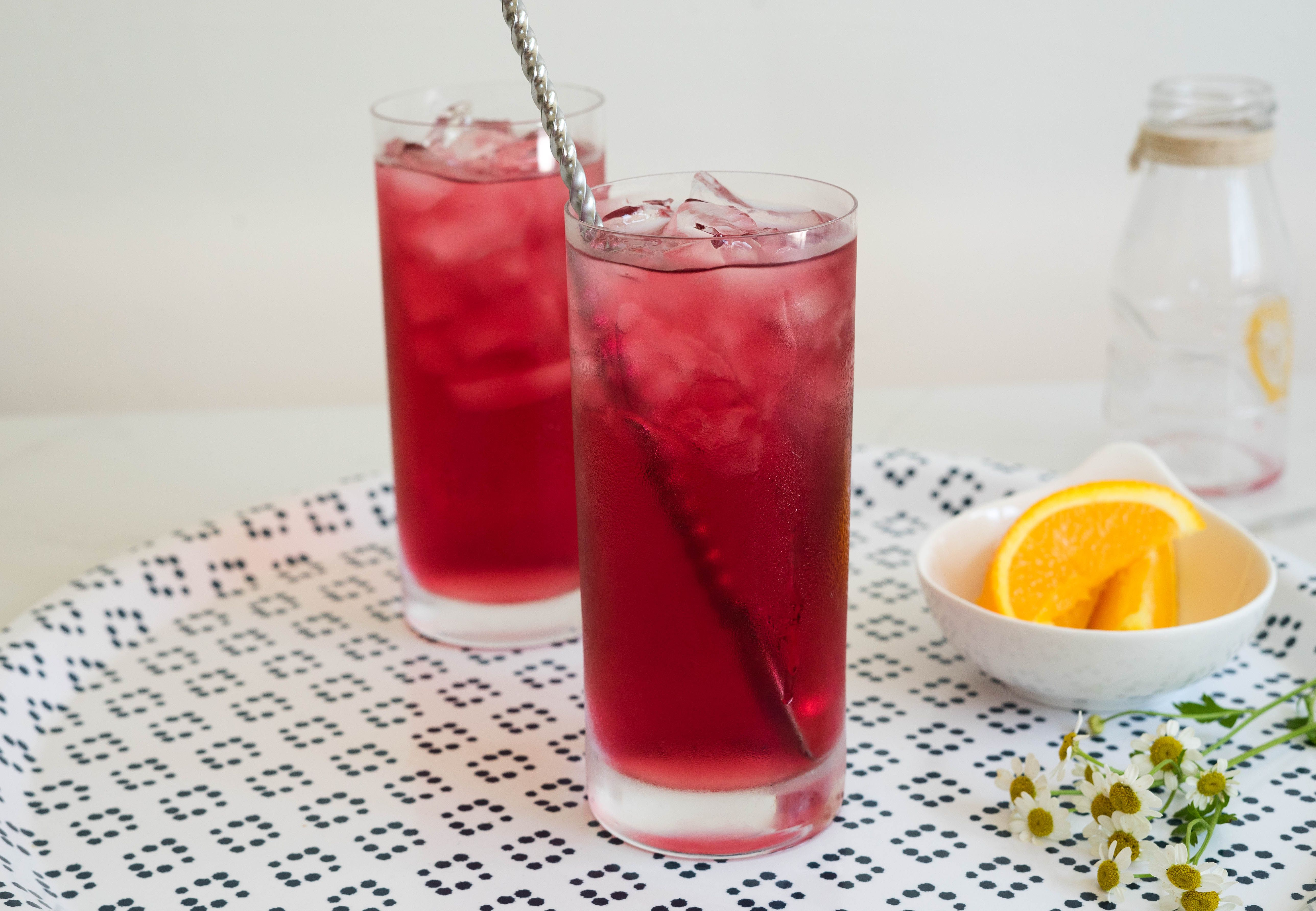 Top vodka with cranberry juice for cocktail.