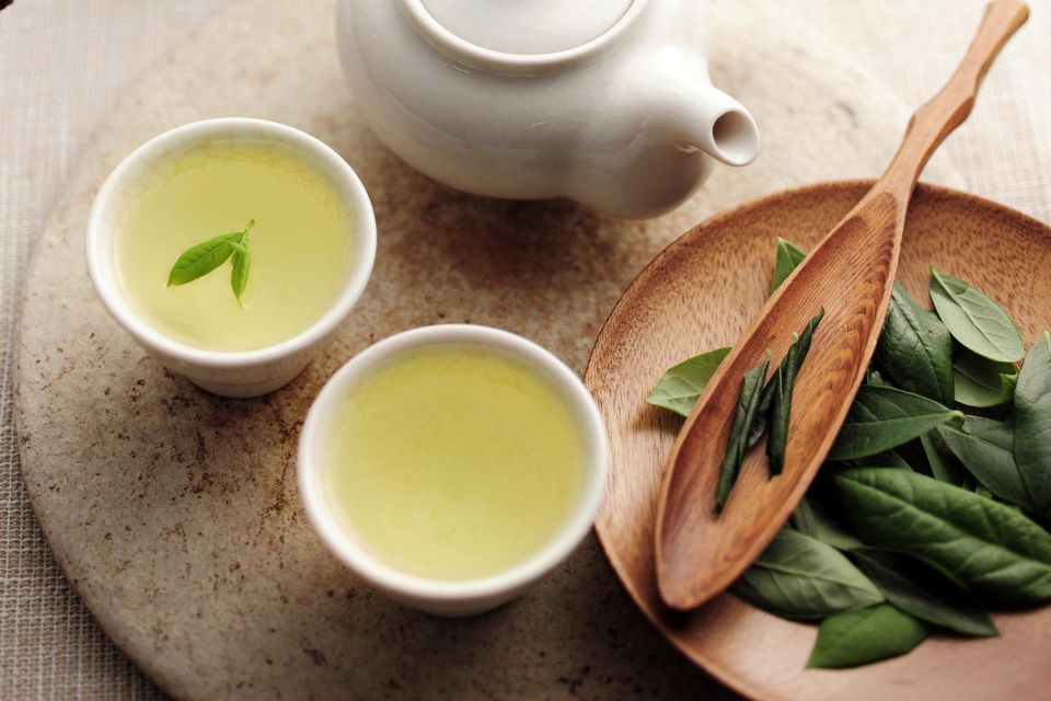 Teapot and cup with green tea