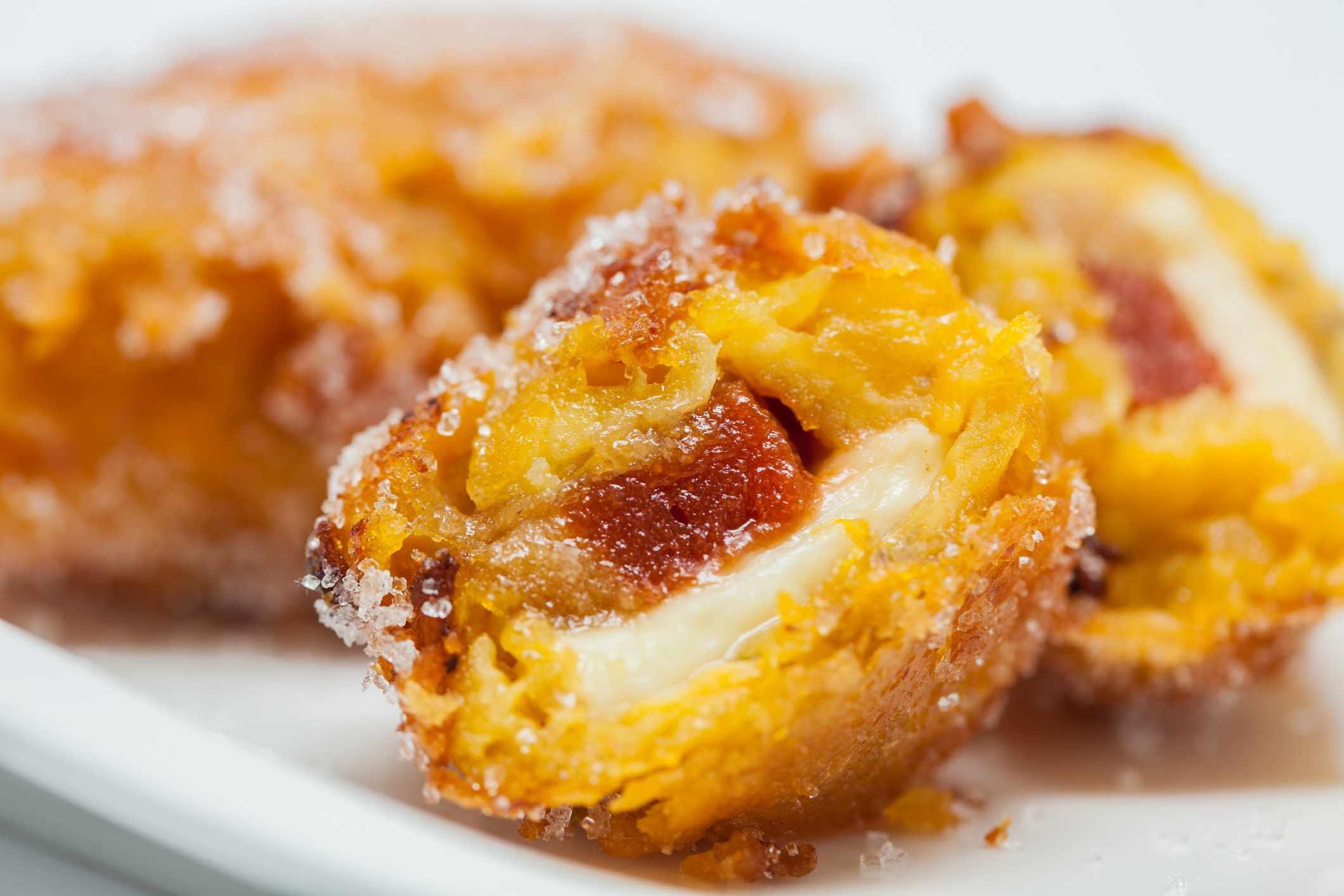 Close-up of aborrajados, fried sweet plantains with cheese on a plate