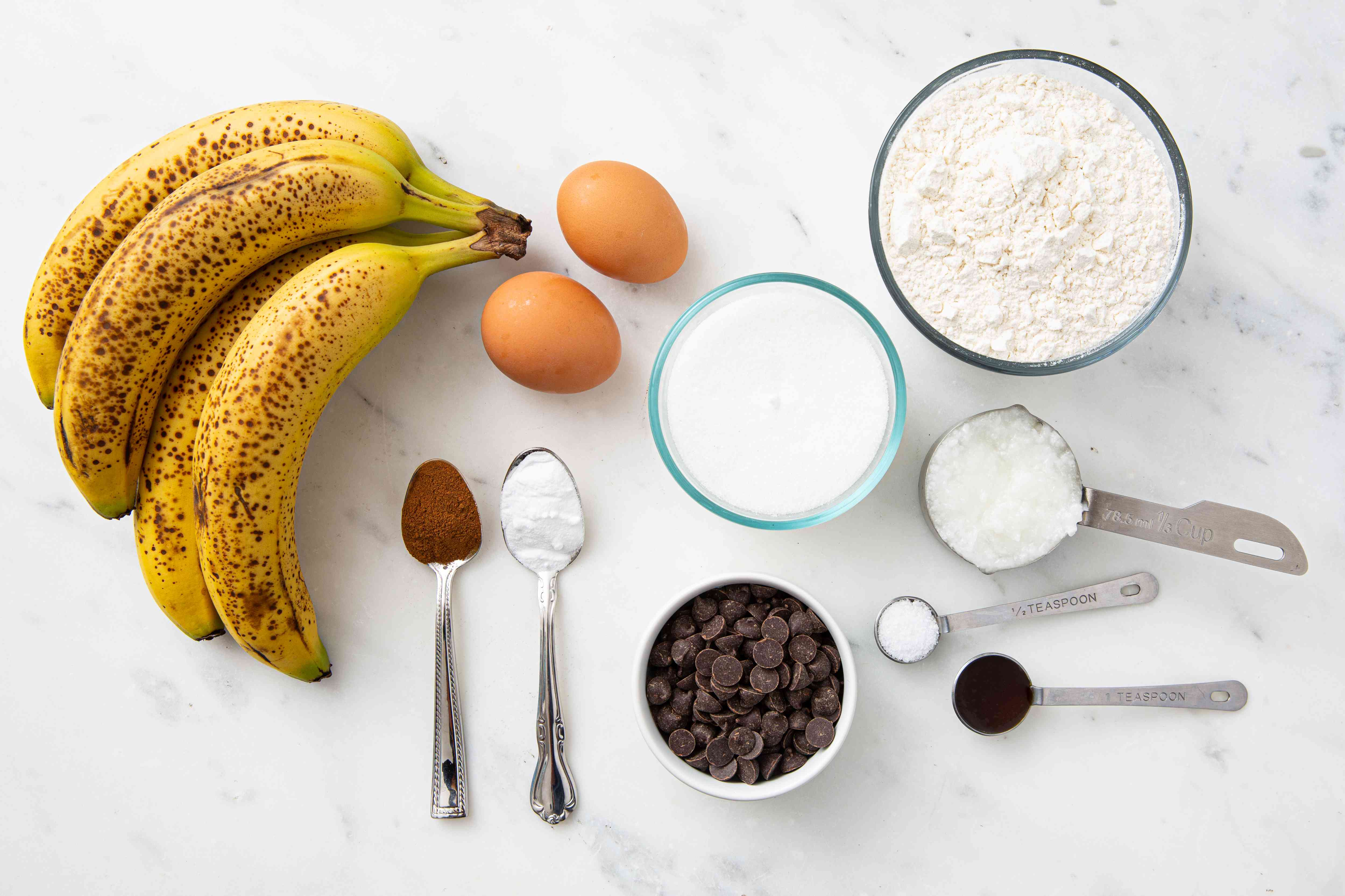 Ingredients for making moist banana bread with coconut oil
