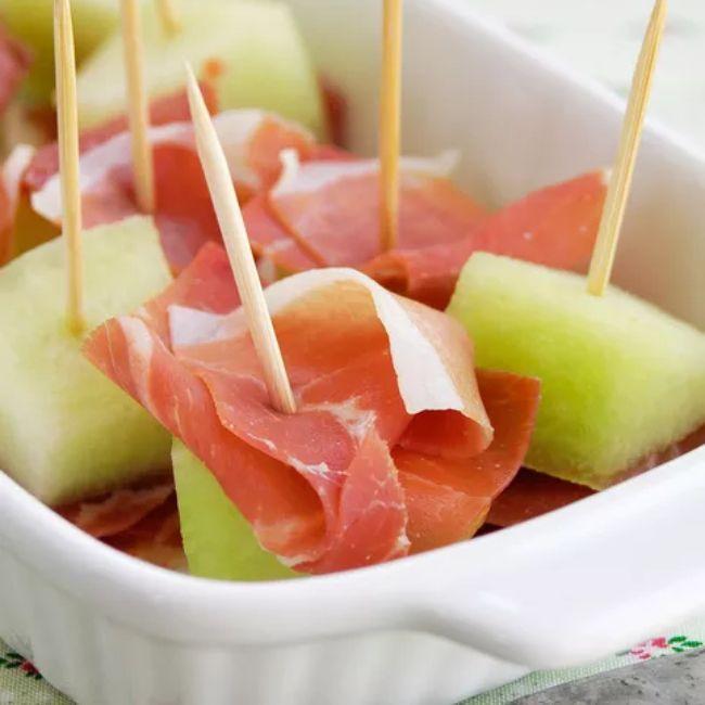 Spanish ham and melon bites