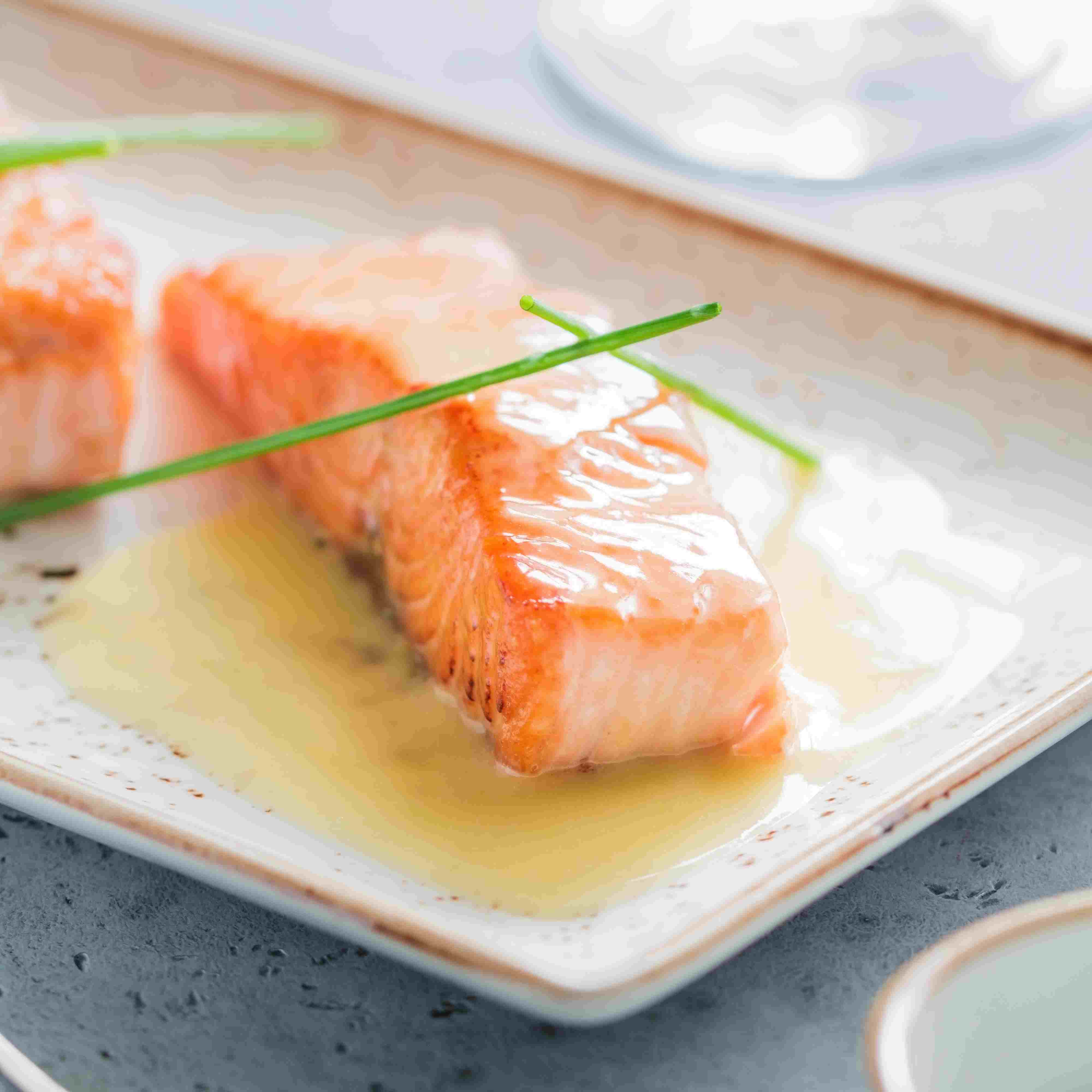 Beurre blanc sauce served atop cooked salmon