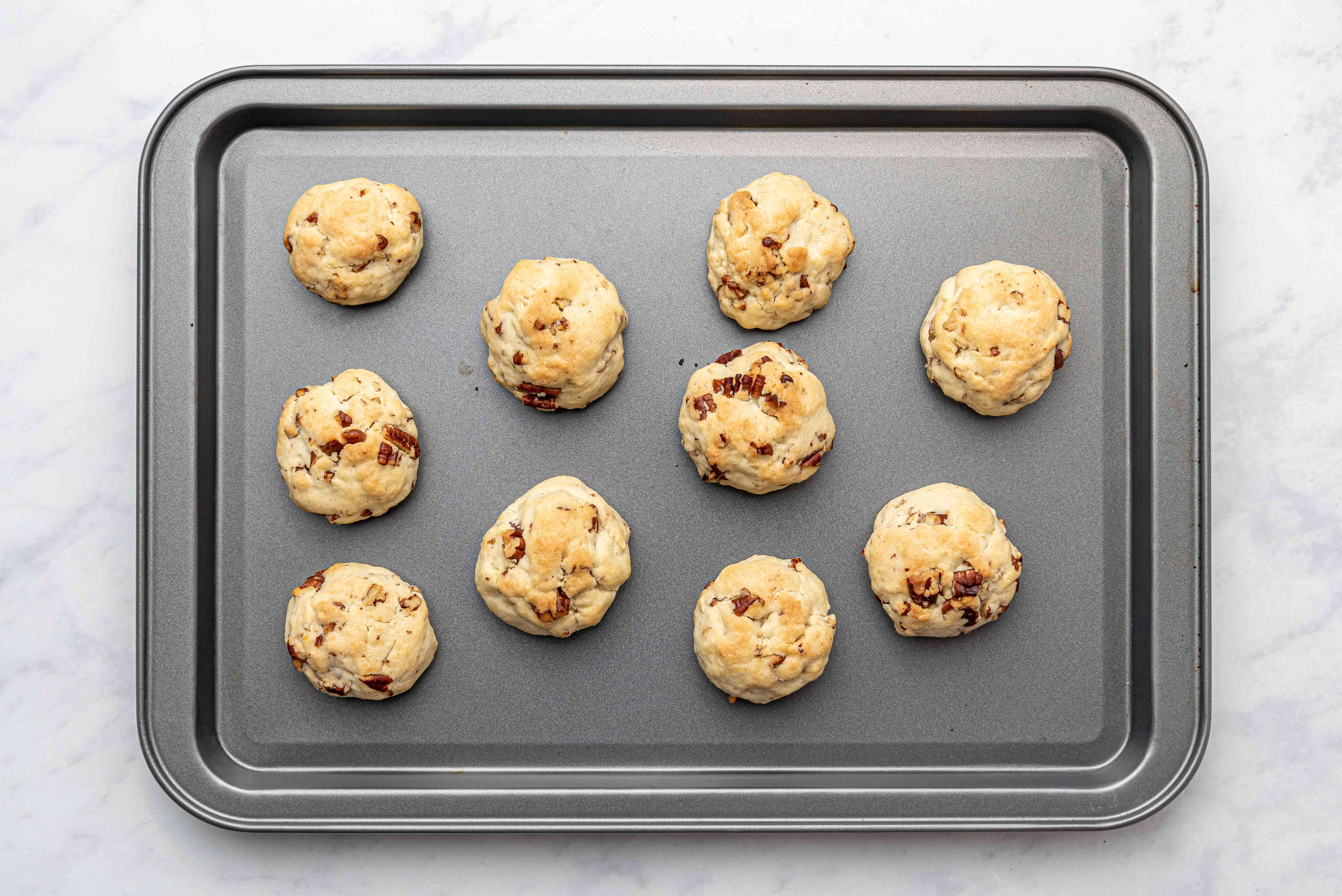 baked Mexican Tea Cakes on a baking sheet