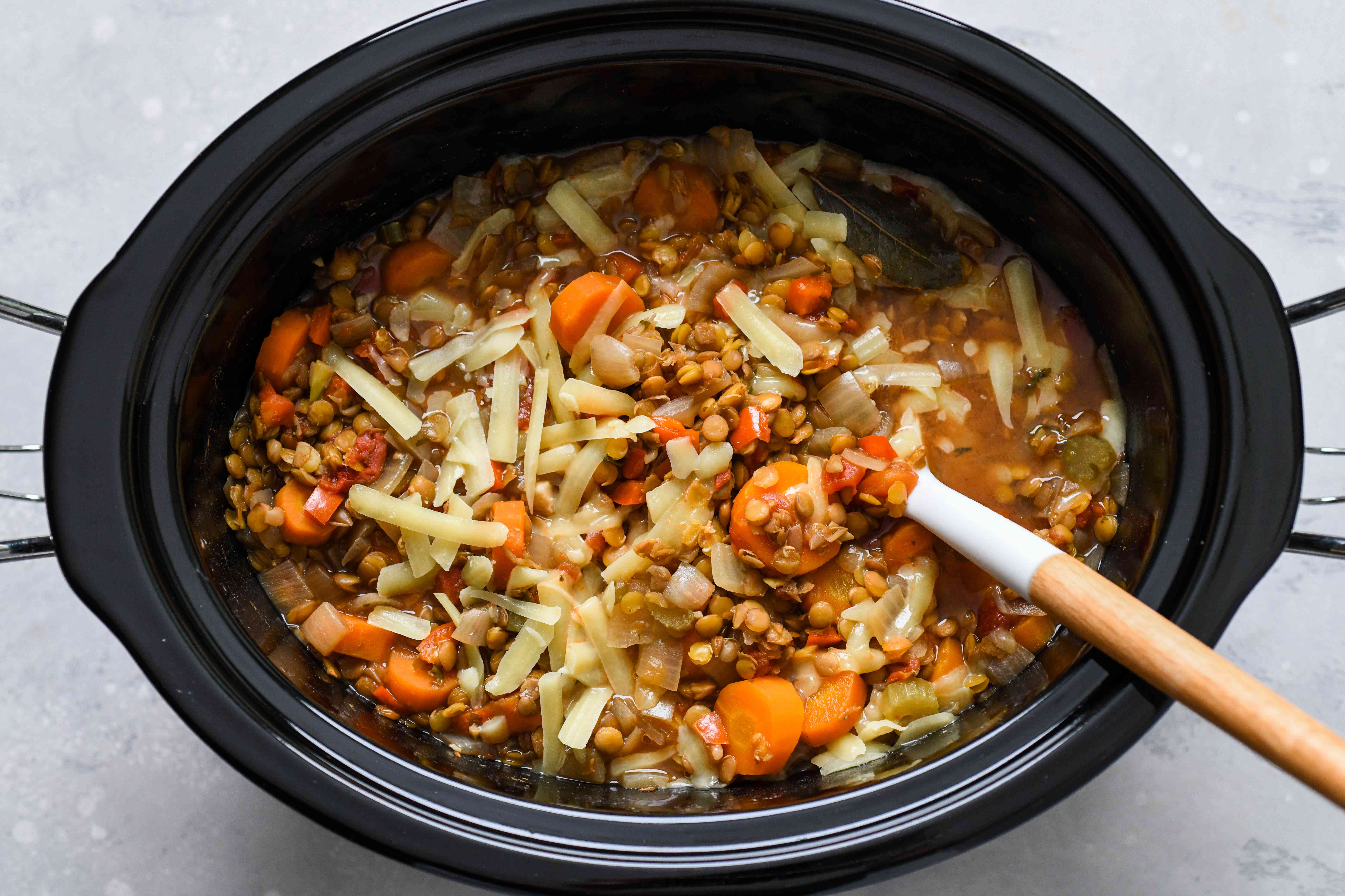 Stir the cheese into the slow cooker until it is melted
