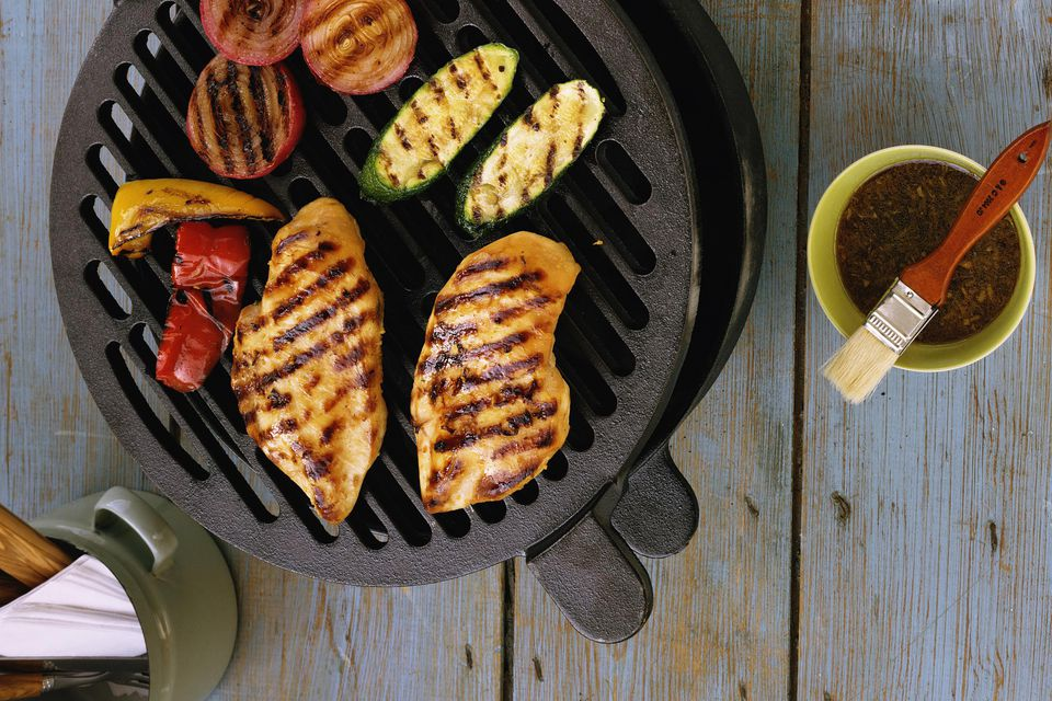 Chicken on a grill with vegetables