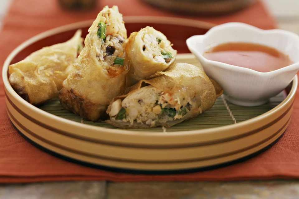 Spring rolls on a plate with dipping sauce