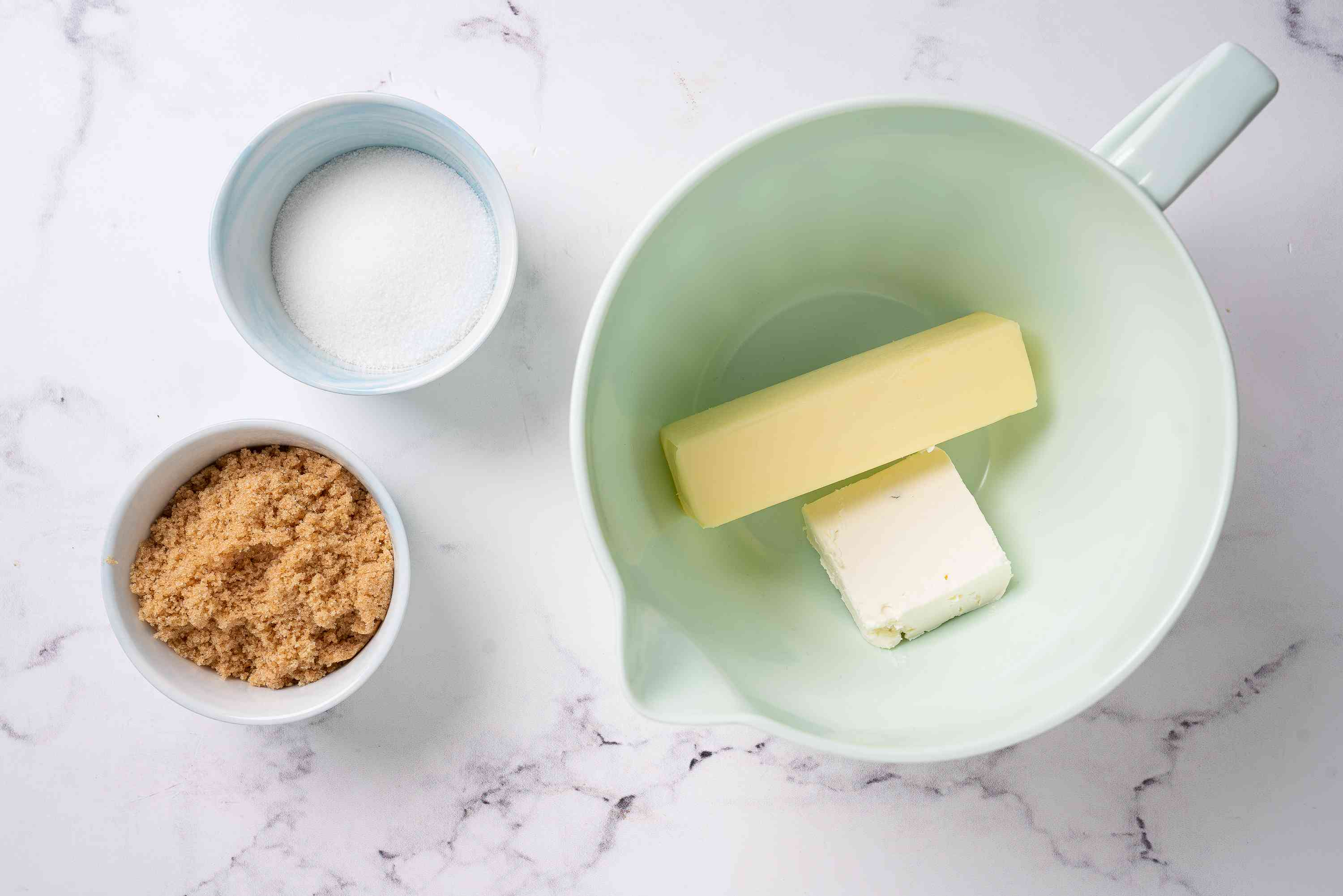 Cream cheese and butter in a bowl