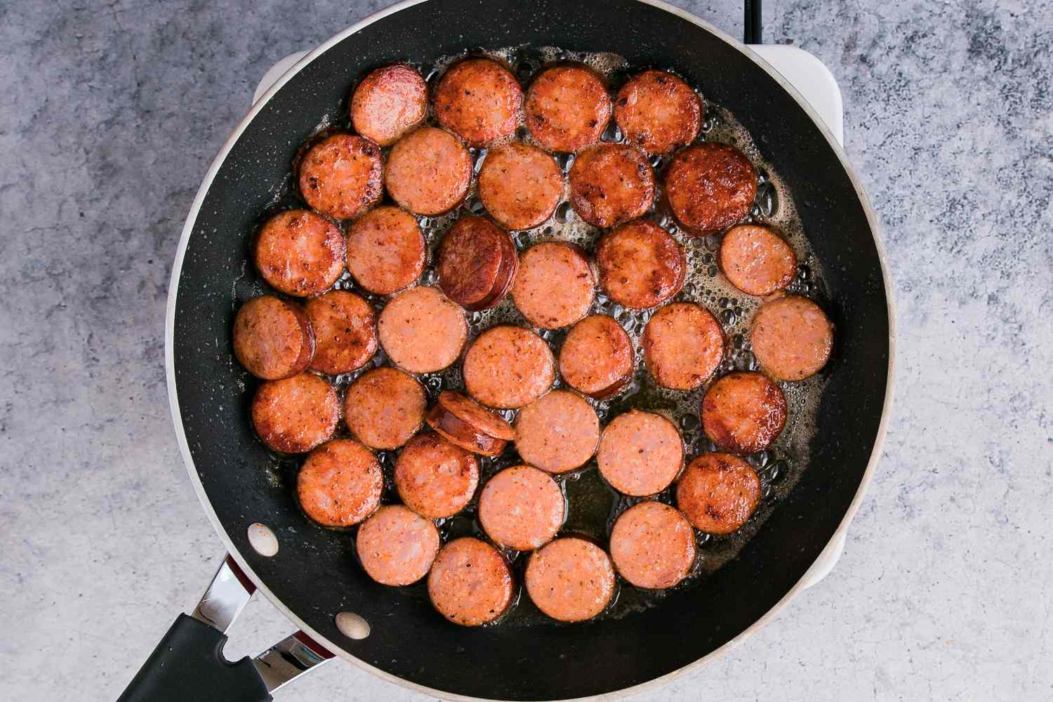 In a small saucepan, heat butter and sauté the smoked sausage until browned