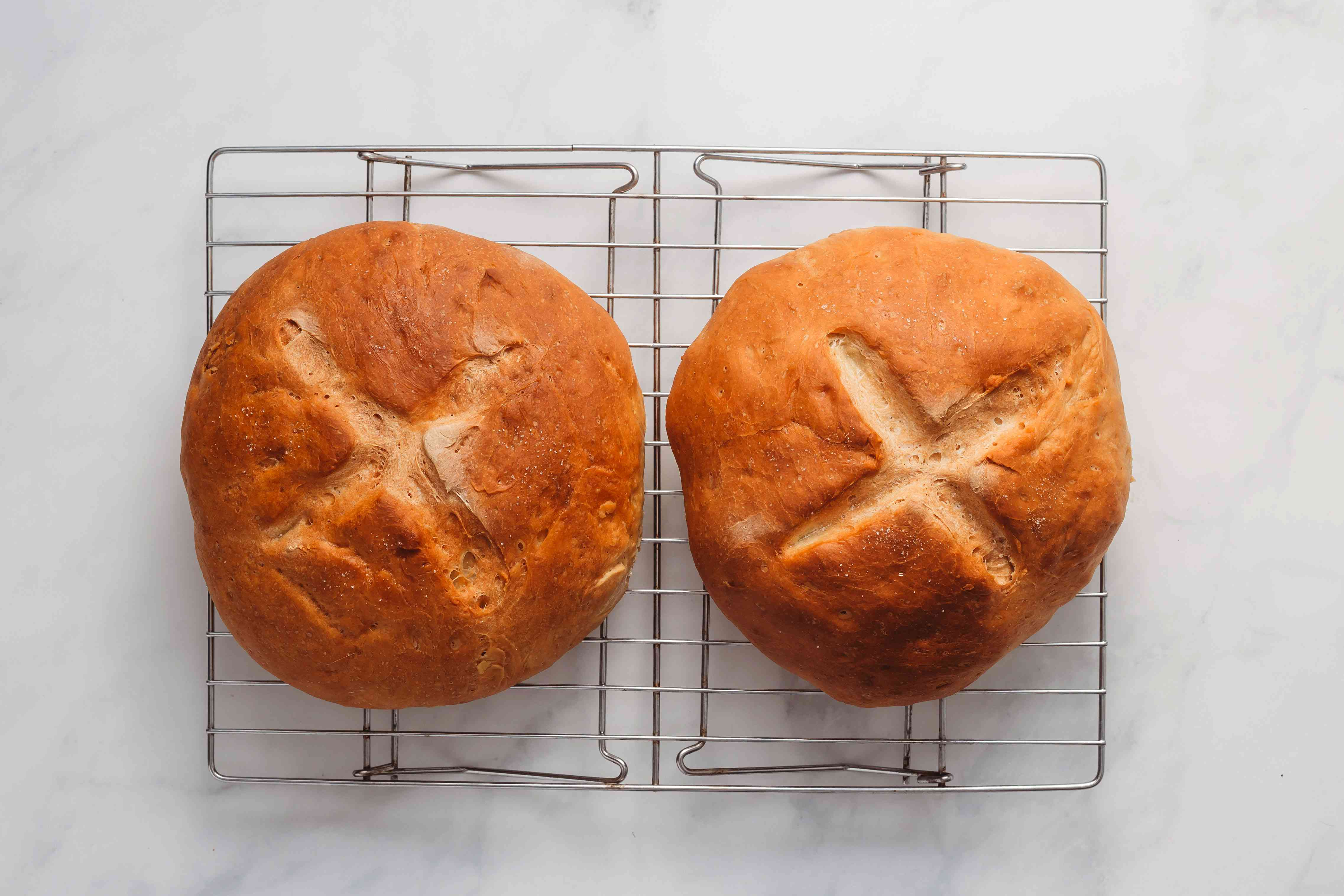 Amish Sourdough Bread loaves on a cooling rack