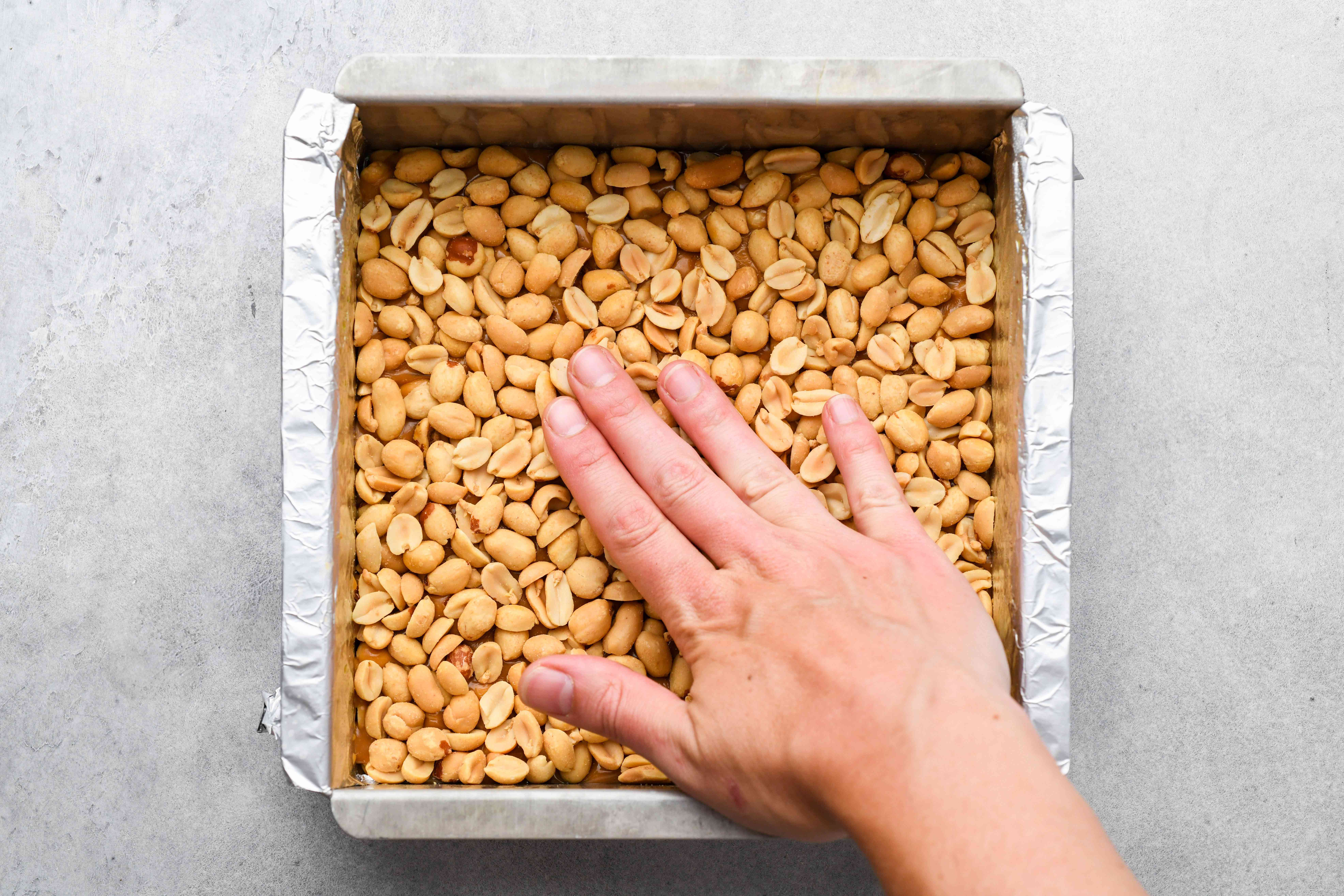 layer of peanuts on top of the caramel mixture in the pan