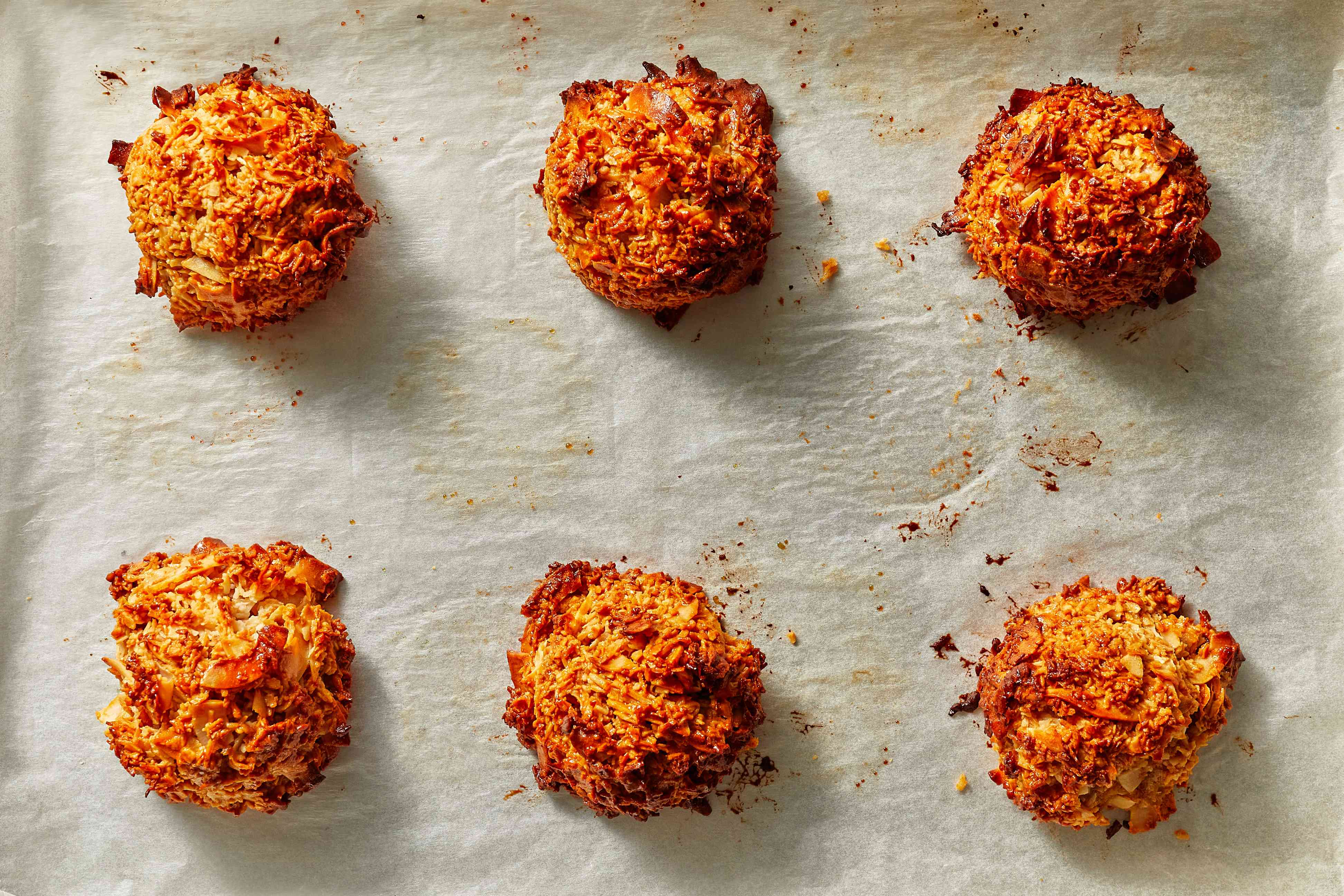 Cocadas - Coconut Macaroons With Dulce de Leche and Chocolate on a baking sheet