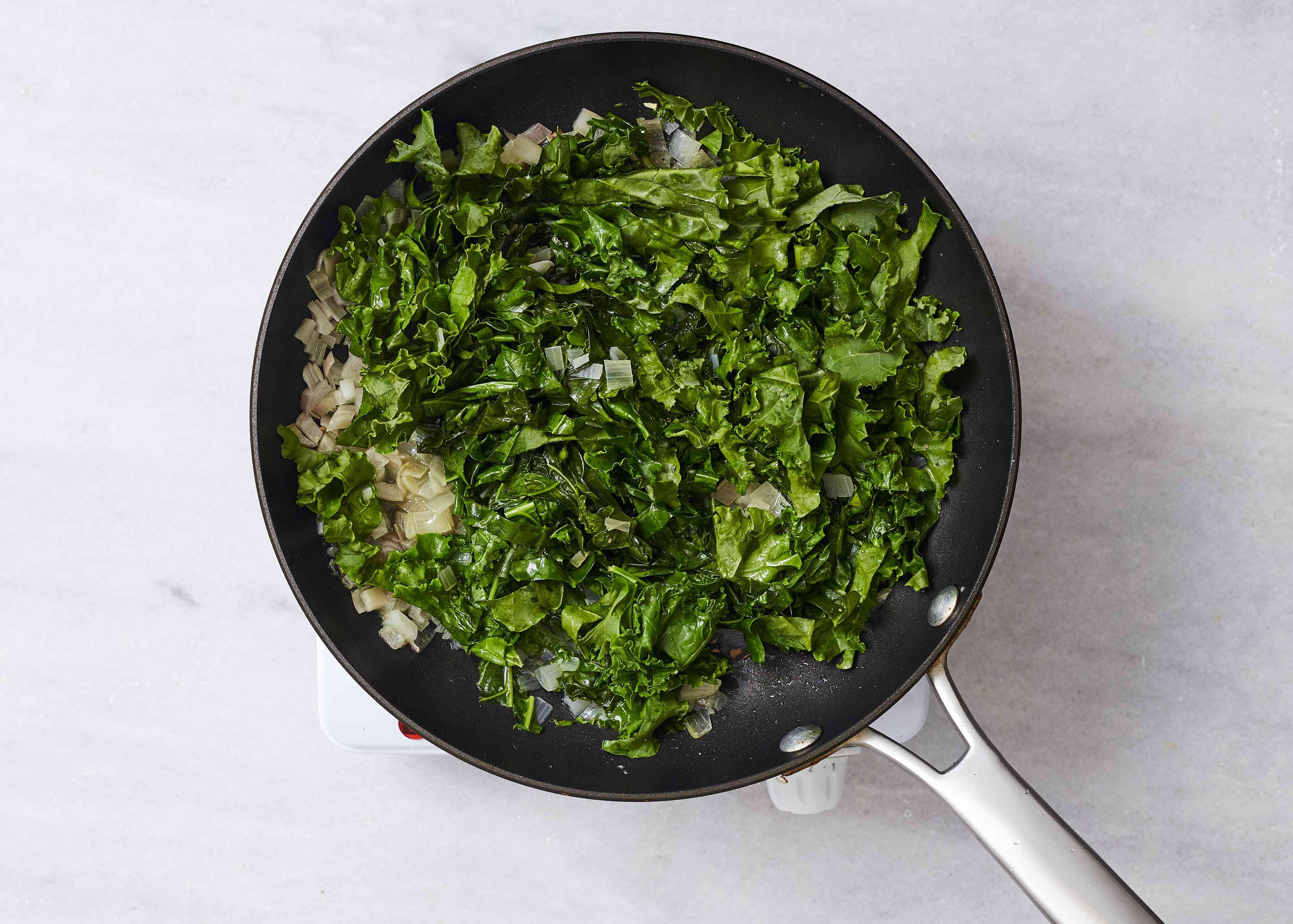 kale cooking in a pan