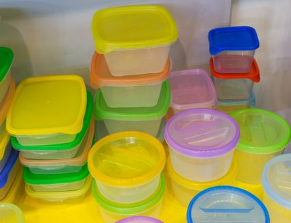 Colorful plastic reusable containers on counter