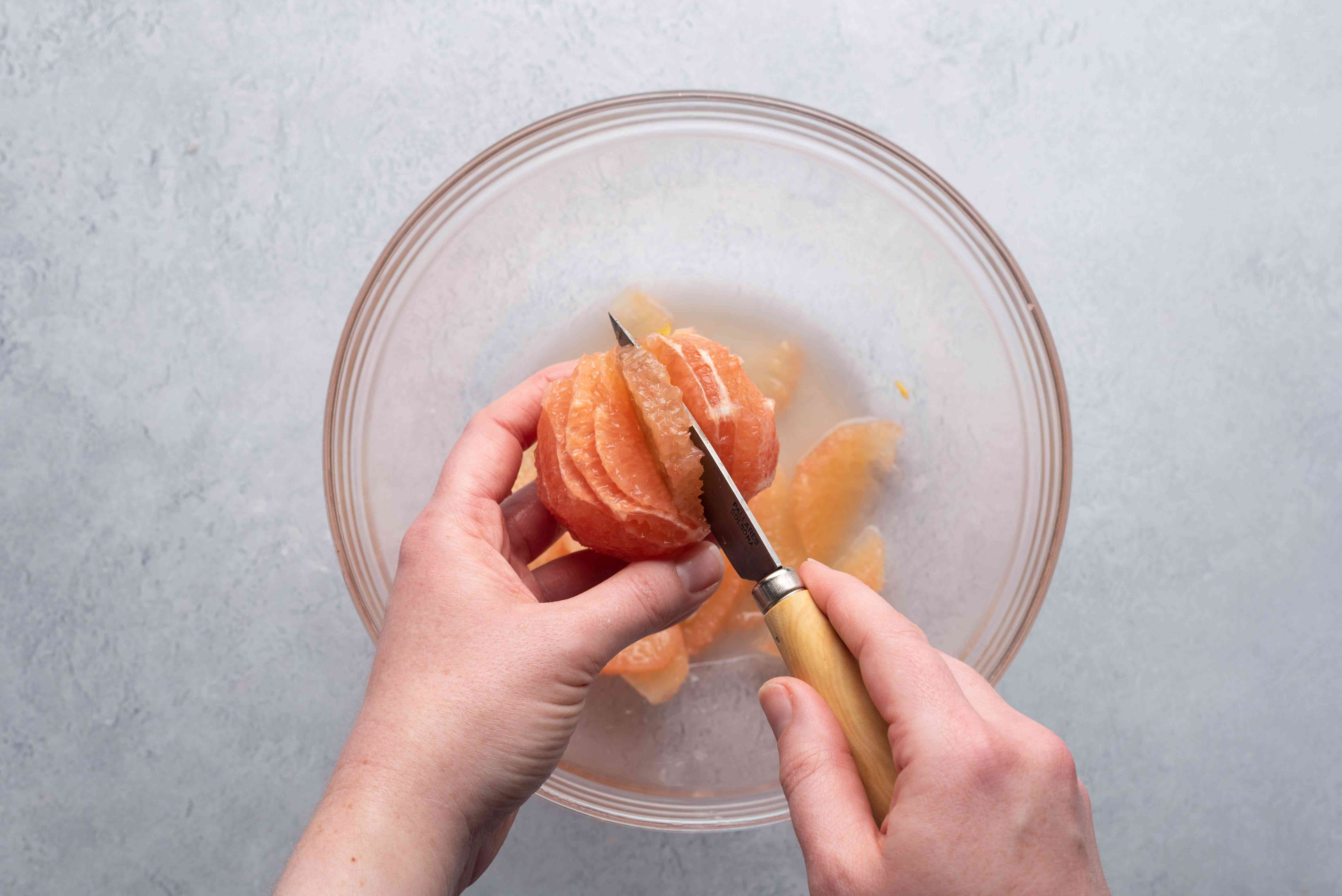 cut out grapefruit sections into a bowl