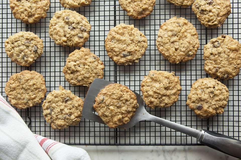 oatmeal raison cookies on cooling rack with spatula