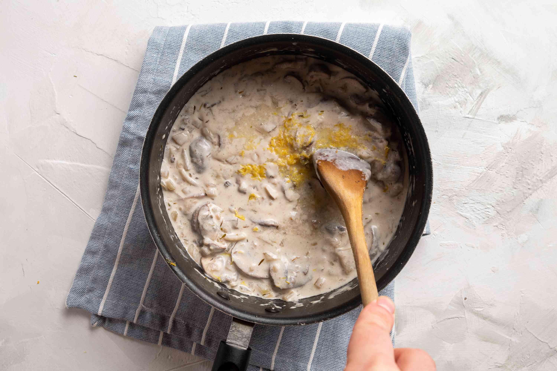Lemon zest added to the mushroom gravy in the saucepan