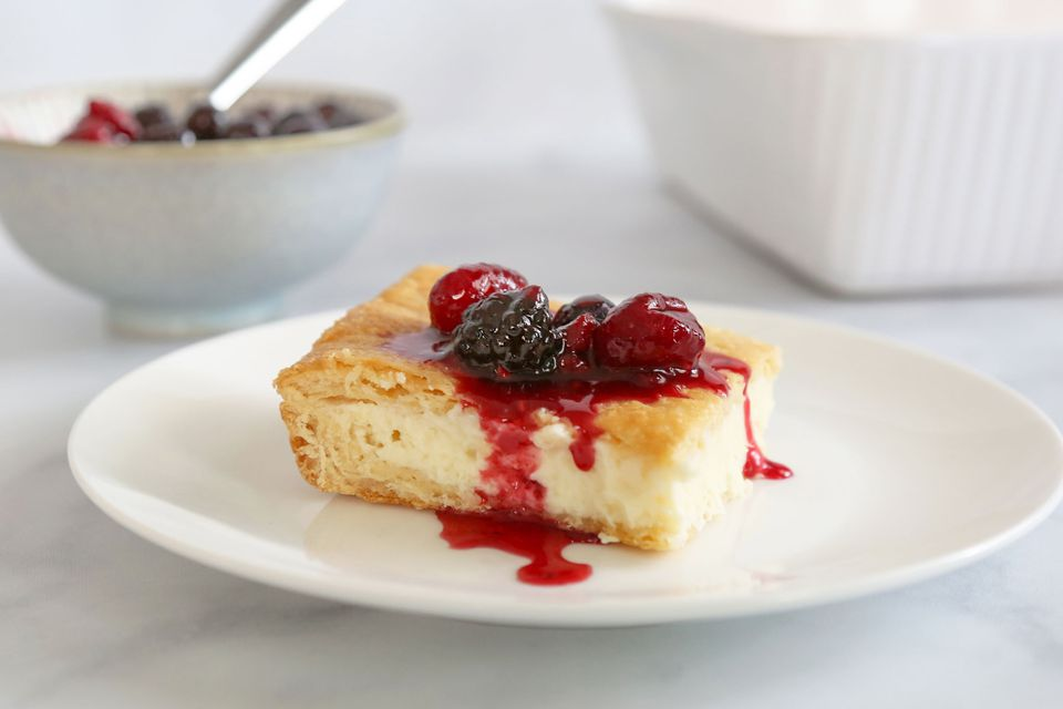 Slice of cheese danish topped with berries