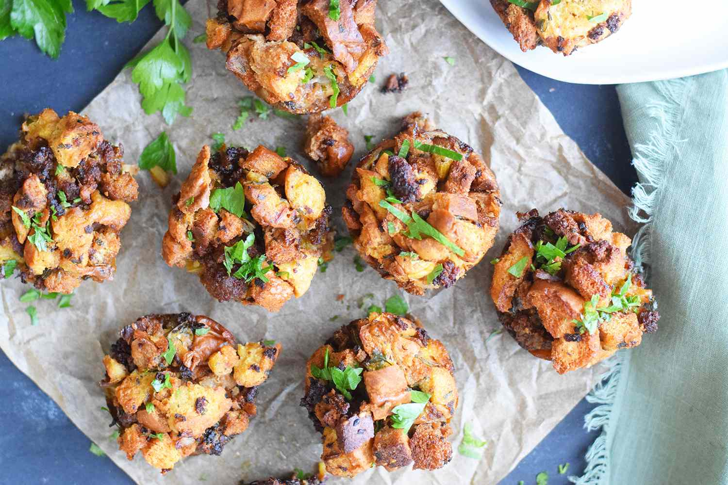 Baked stuffing muffins on parchment paper