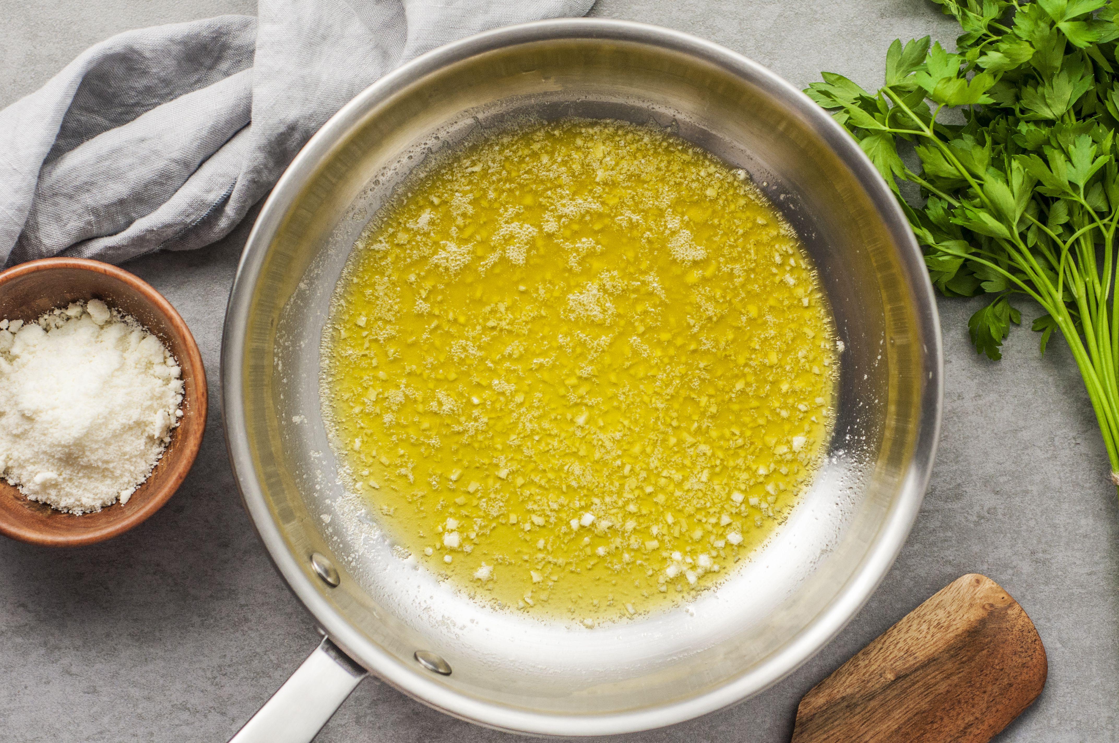 Olive oil, butter in garlic in frying pan