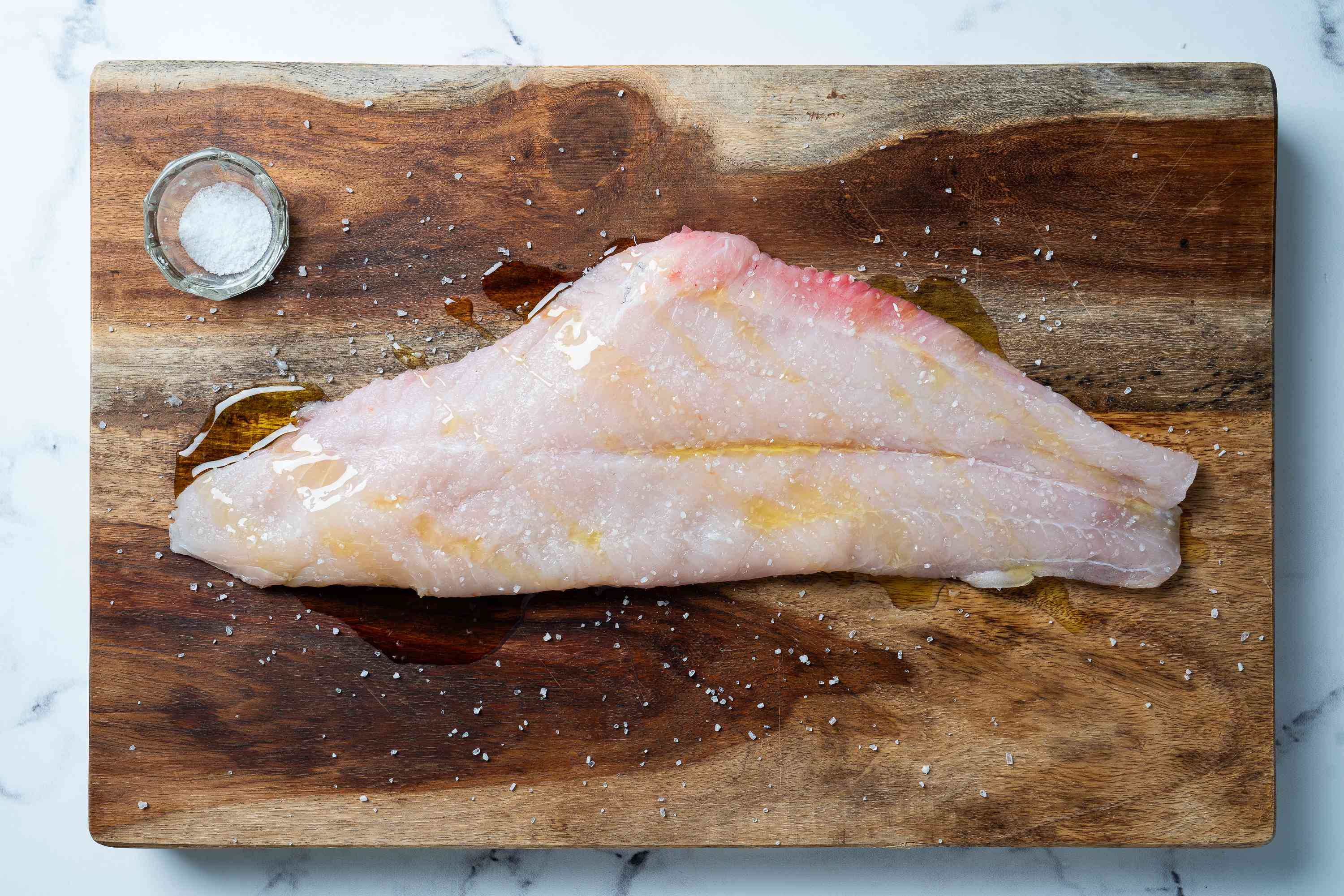 Catfish fillets drizzled with oil