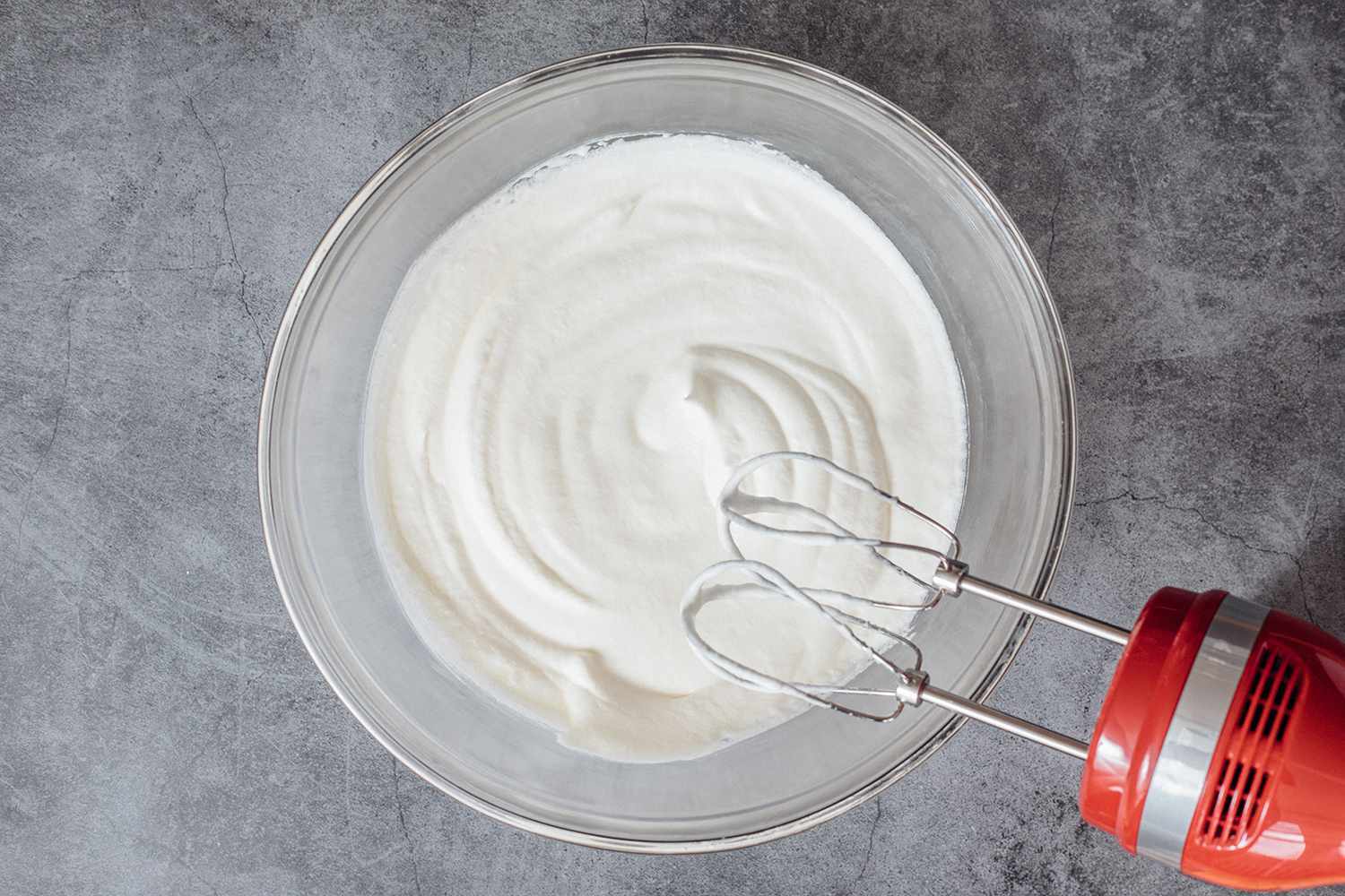 beating whip cream with a hand mixer