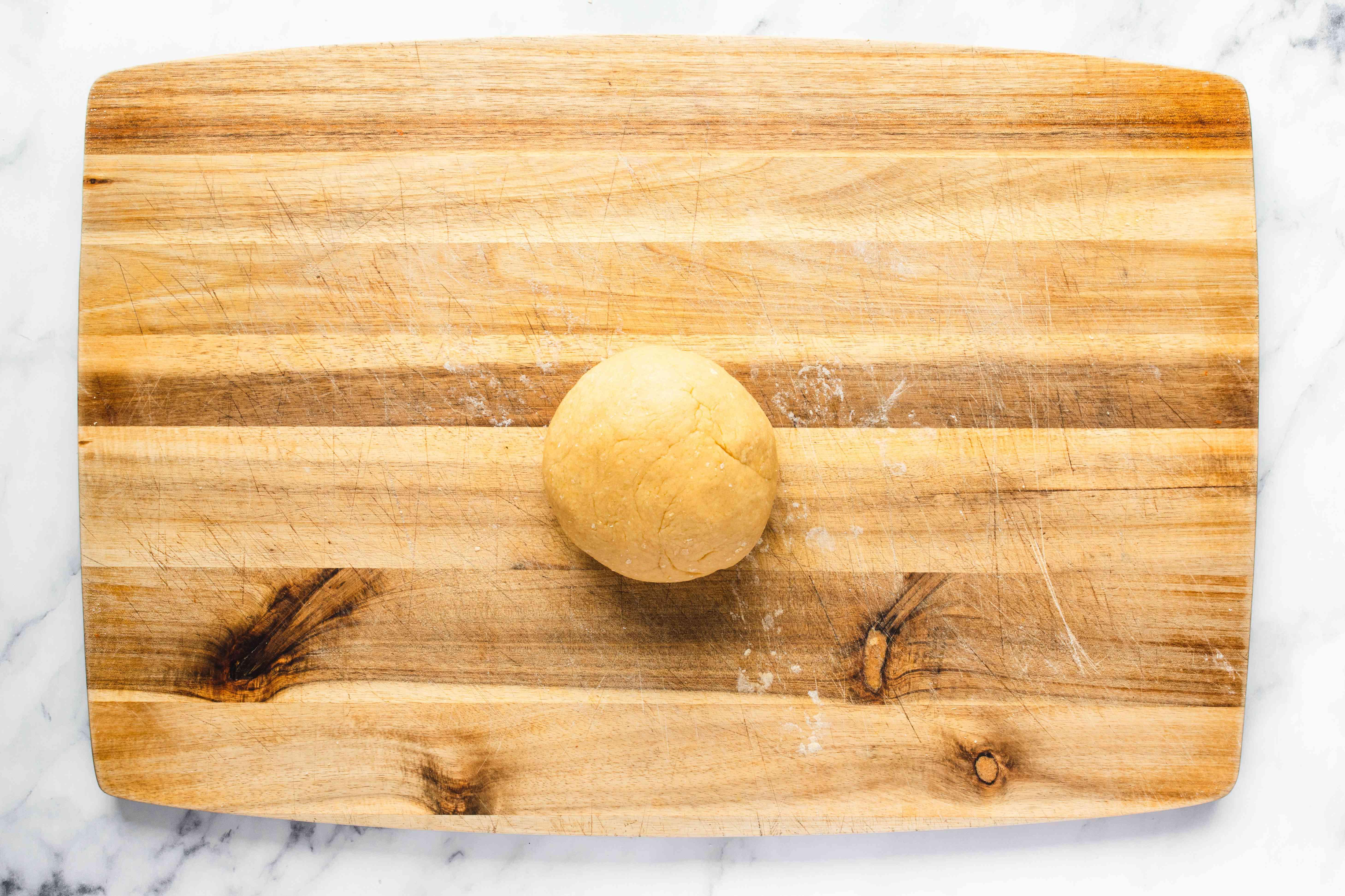 Sift flour and create dough for pandoro cake
