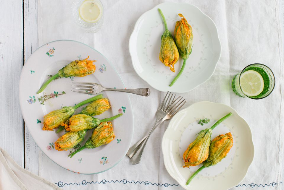 Three plates of stuffed zucchini blossoms
