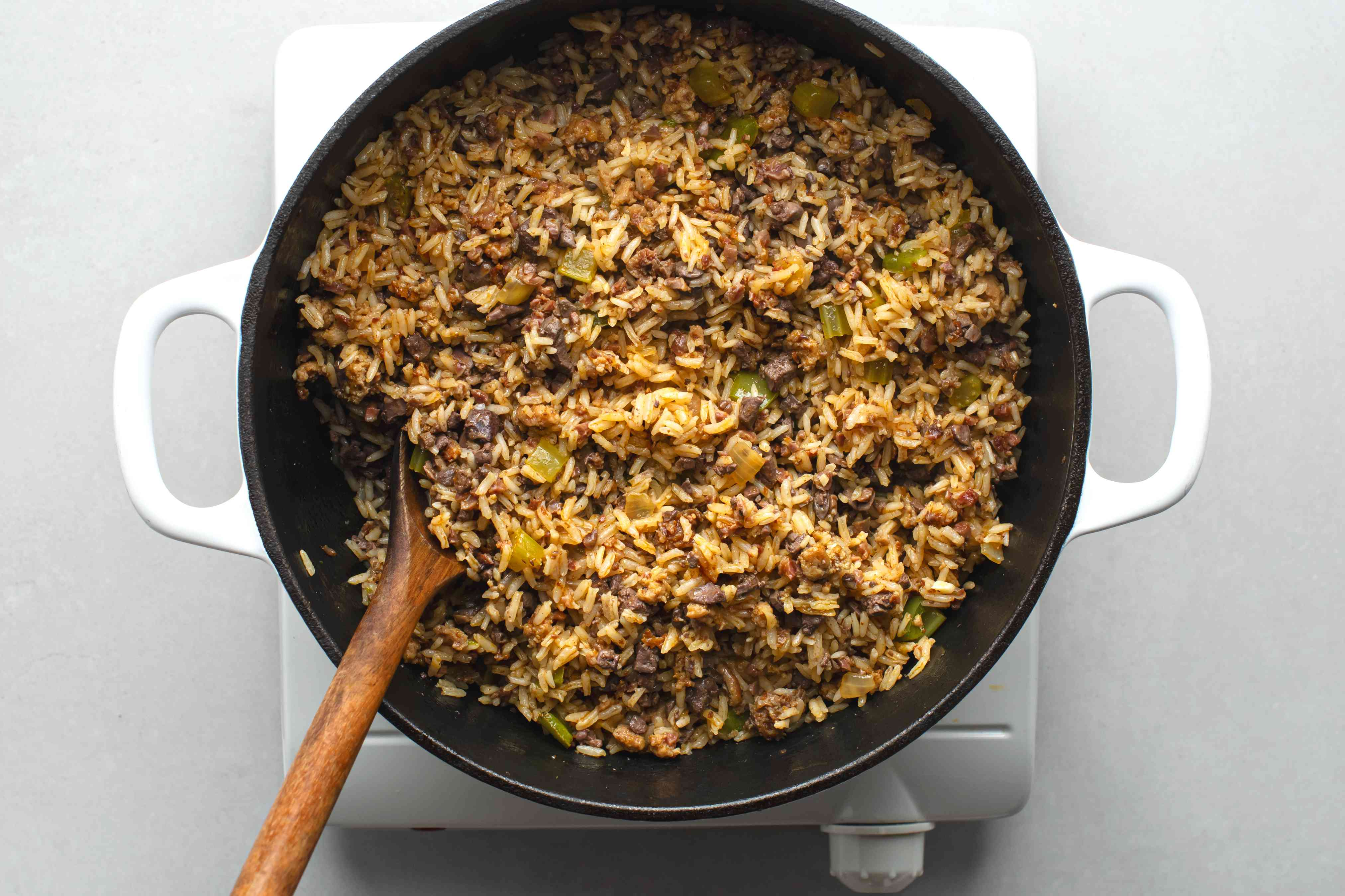 Toss minced chicken livers with the rice mixture in the Dutch oven