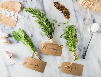 Herbs, salt, twine, and garlic for turkey brine recipe