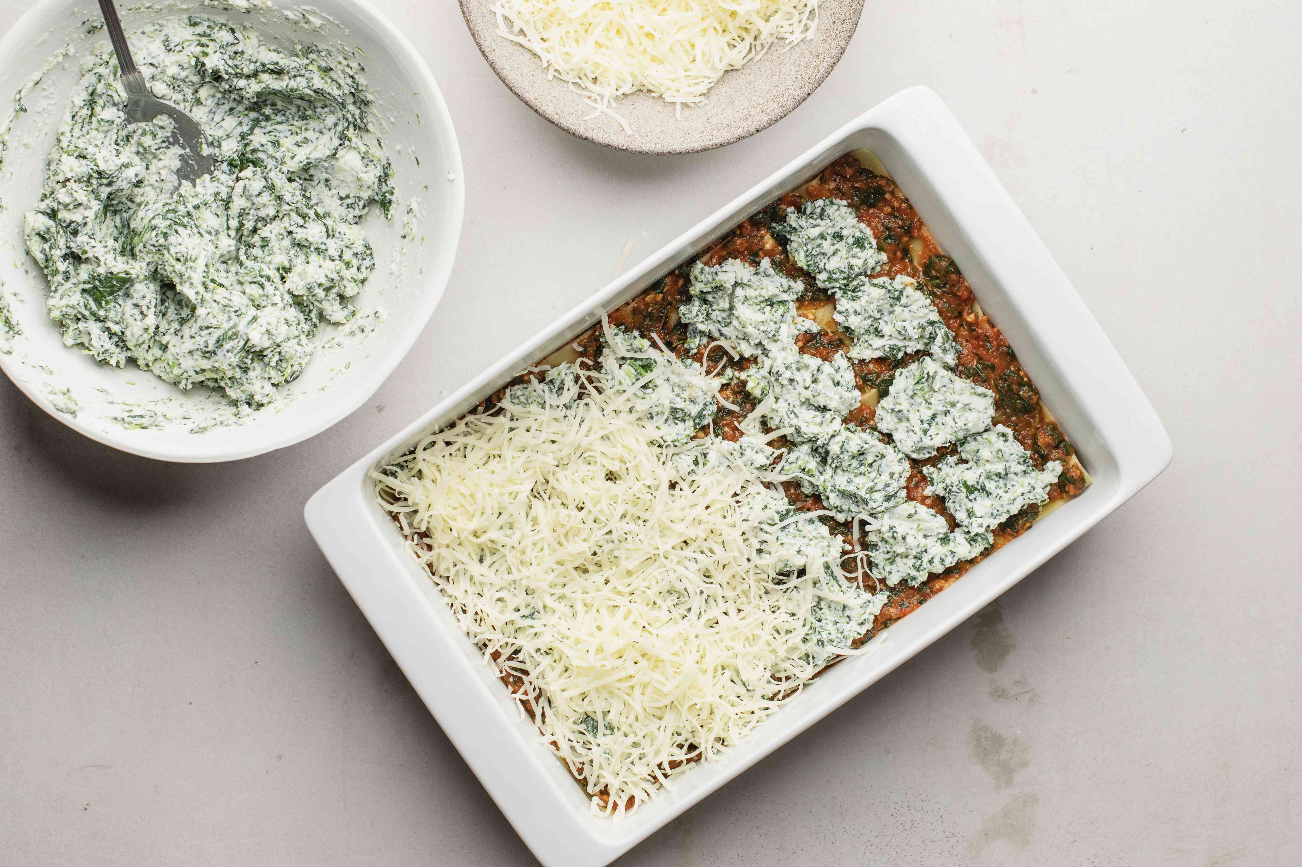 About one-third of the ricotta mixture over the sauce layer for spinach lasagna