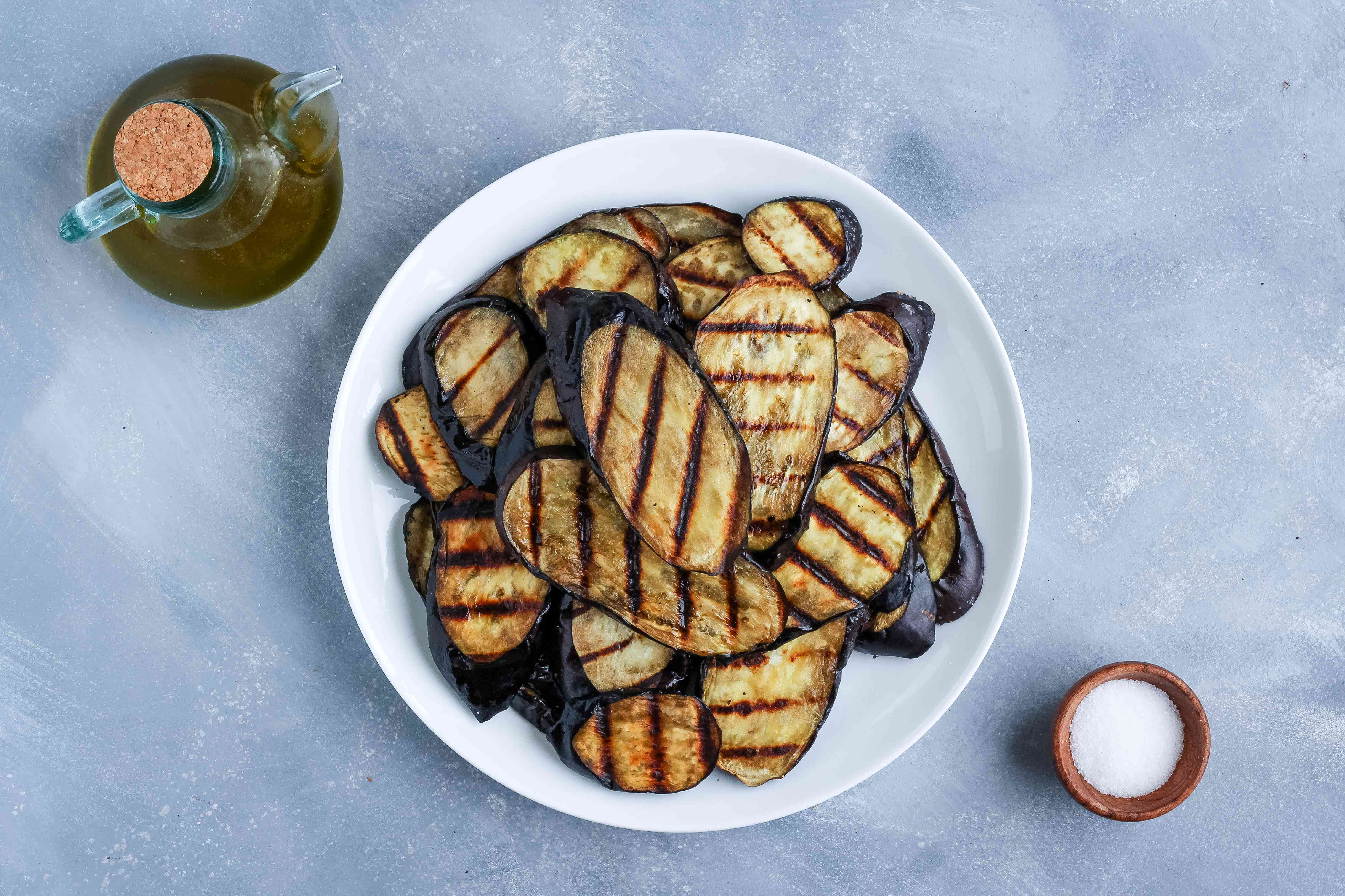 A plate of grilled eggplant with oil and salt