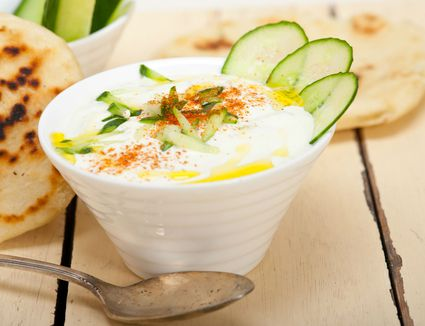 Bowl of tzatziki with cucumbers and mint