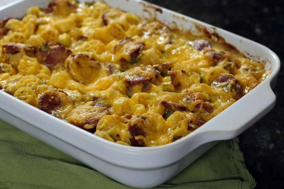 baking dish of pasta wheels and cheese with s;oced andouille sausage
