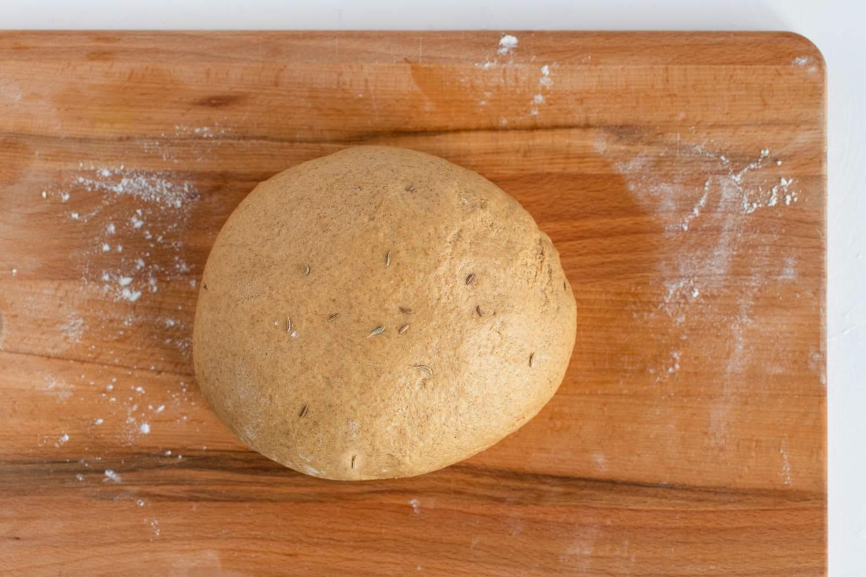 Kneaded pumpernickel bread dough loaf
