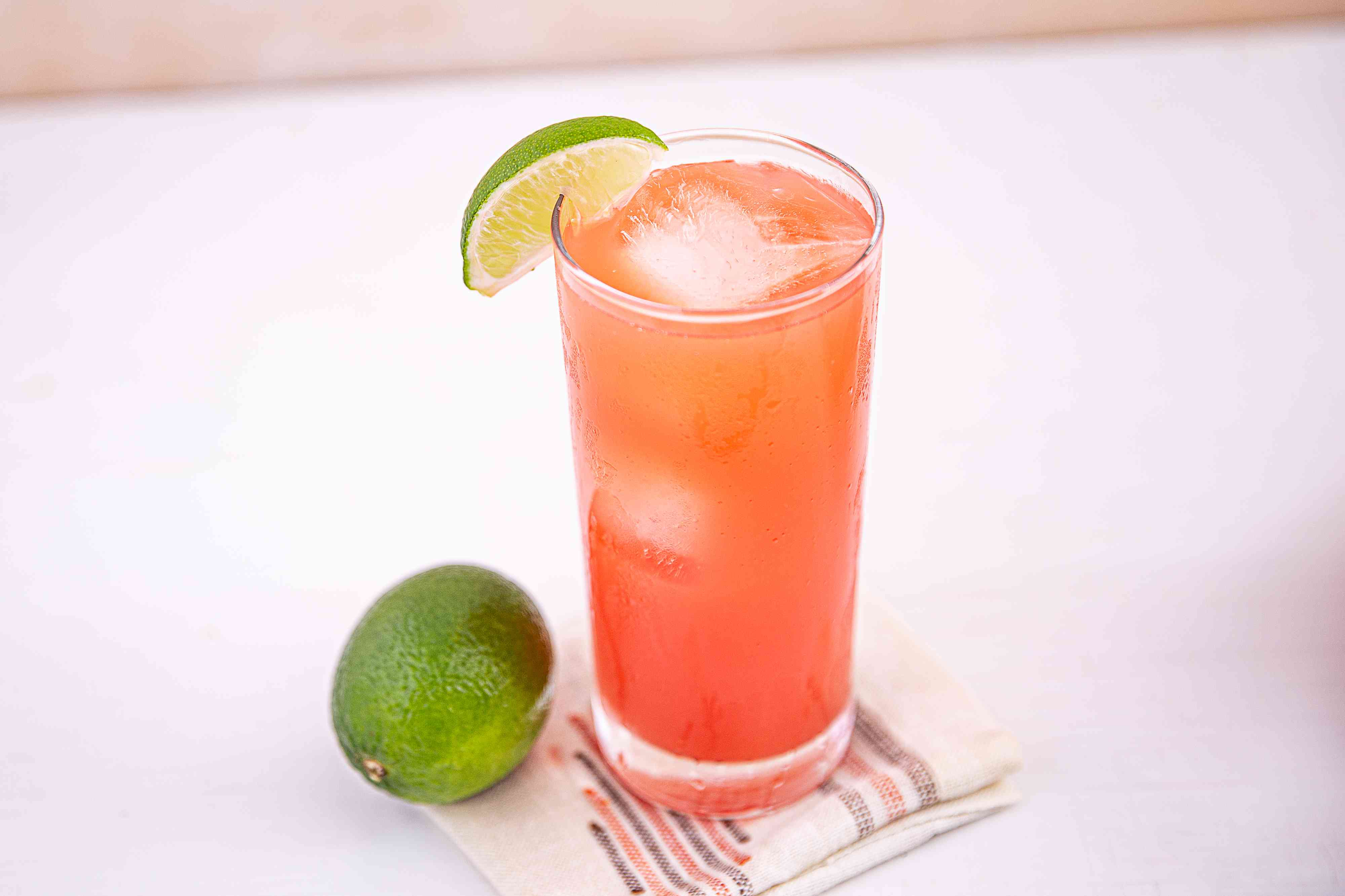 Greyhound cocktail with a lime garnish
