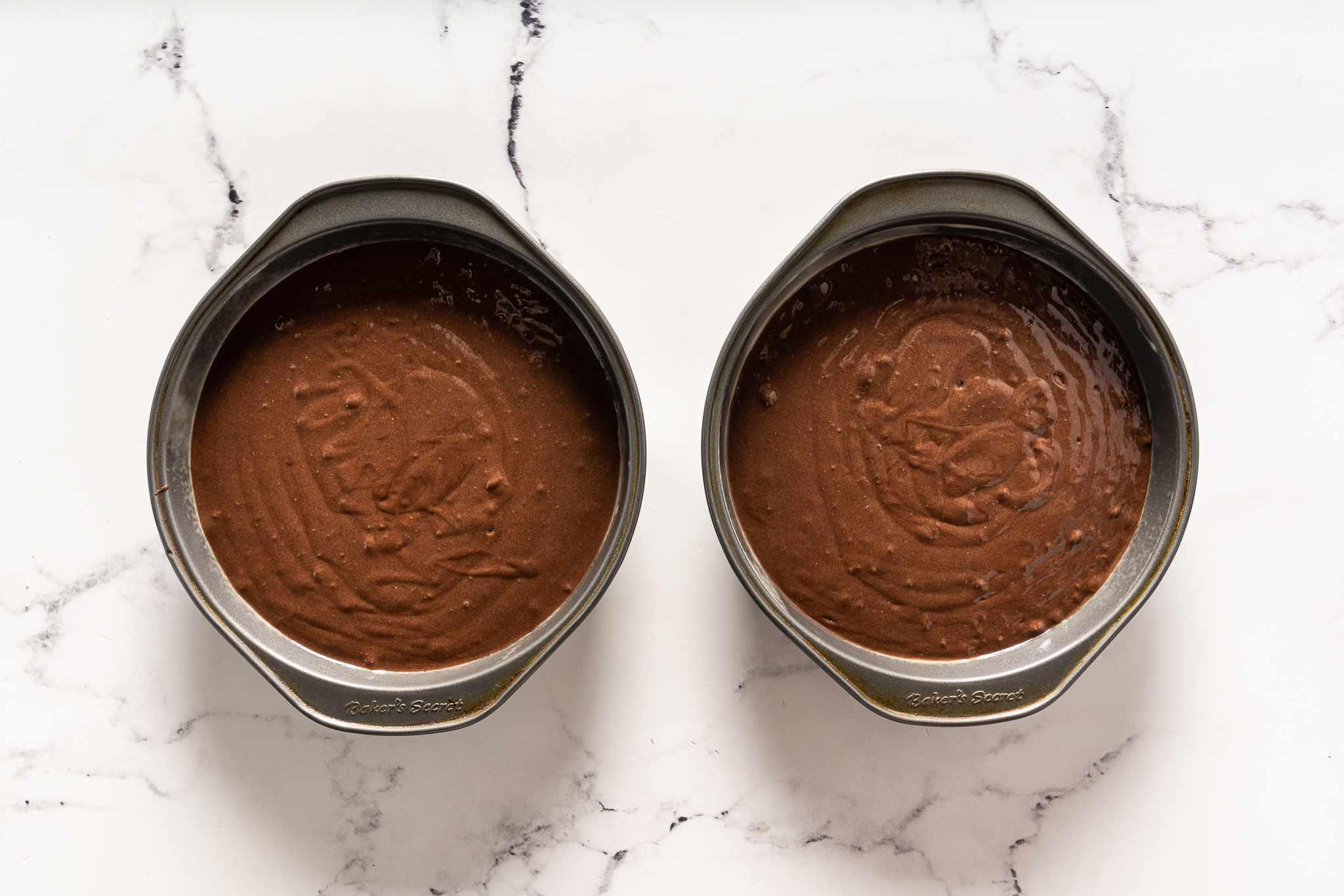 Chocolate cake in baking pans