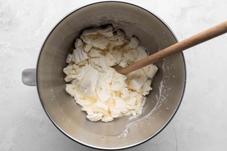 Break meringue into chunks in a bowl
