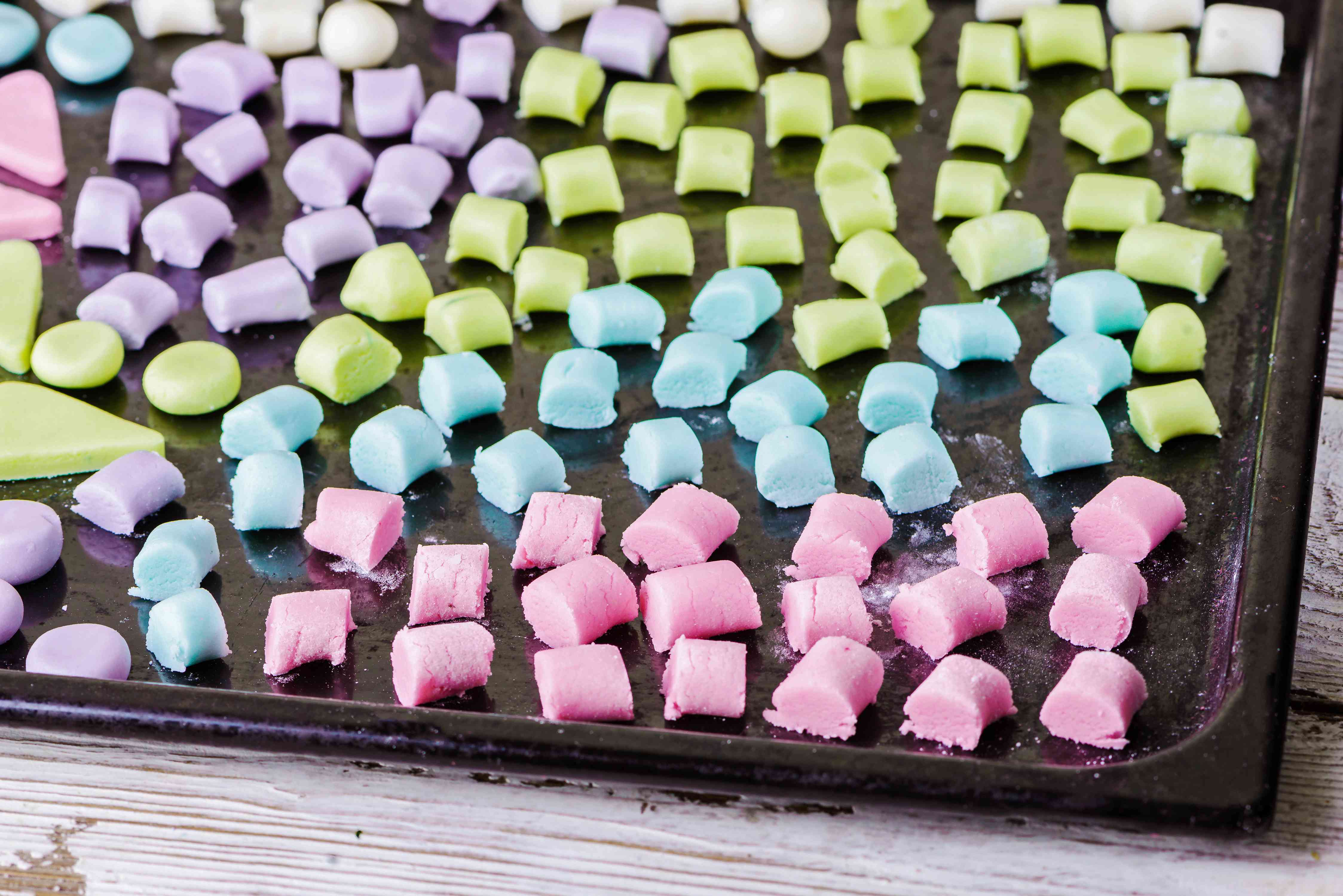 Colorful candy mints on a baking sheet