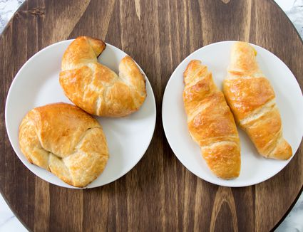 four butter croissants on plate