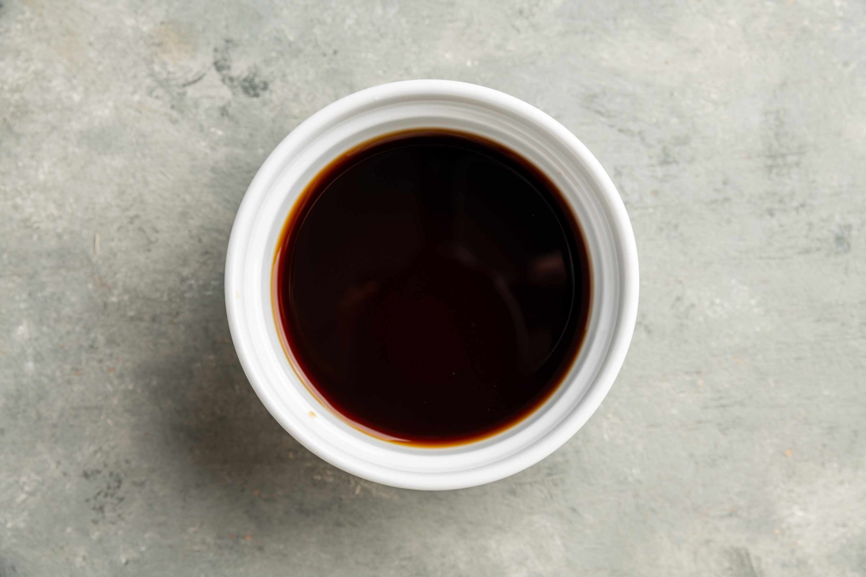 combining the dark and light soy sauces, vinegar, rice wine or dry sherry, sugar, and chicken broth in a small bowl