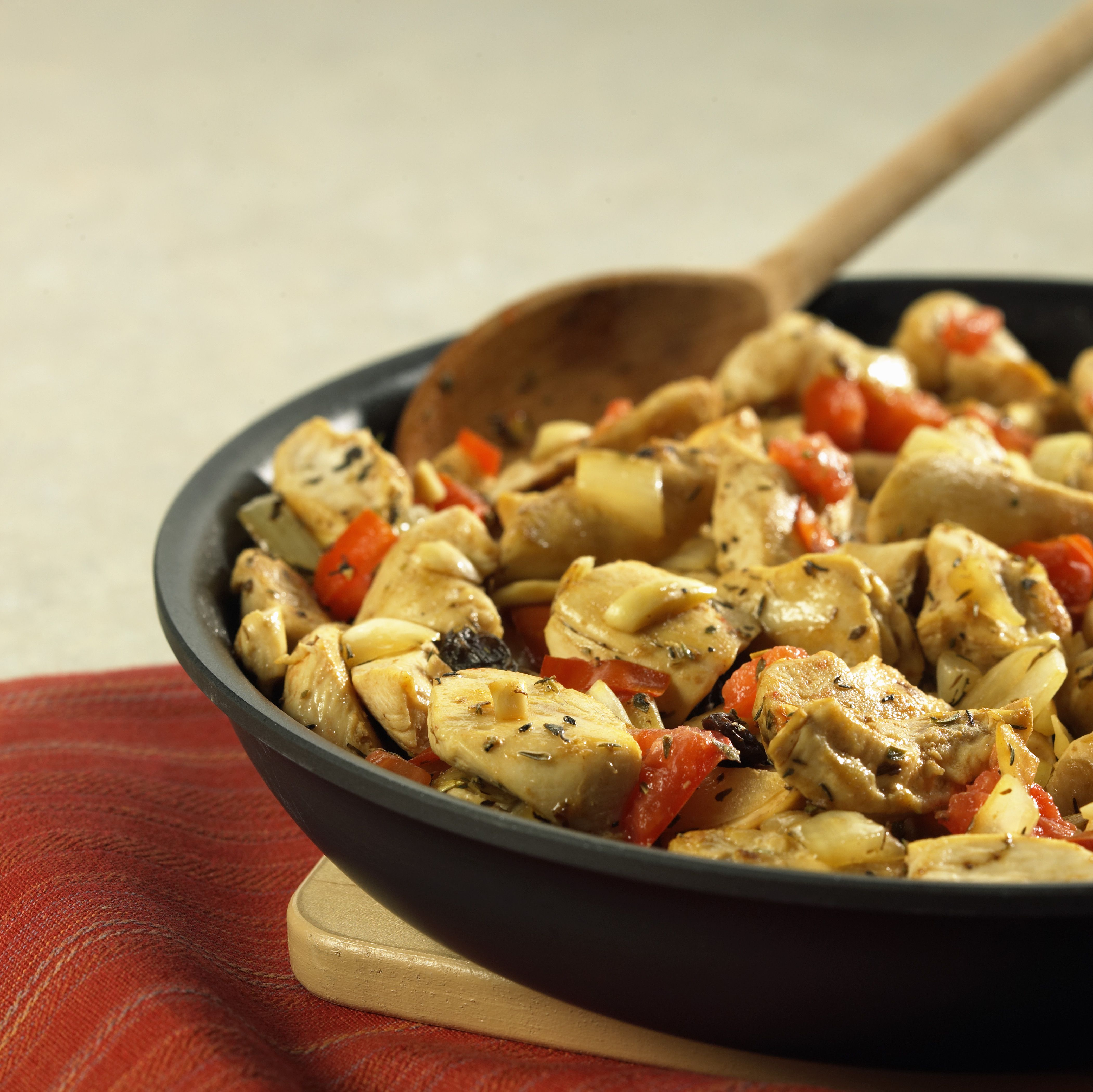 Close-up of sauteed chicken in a pan