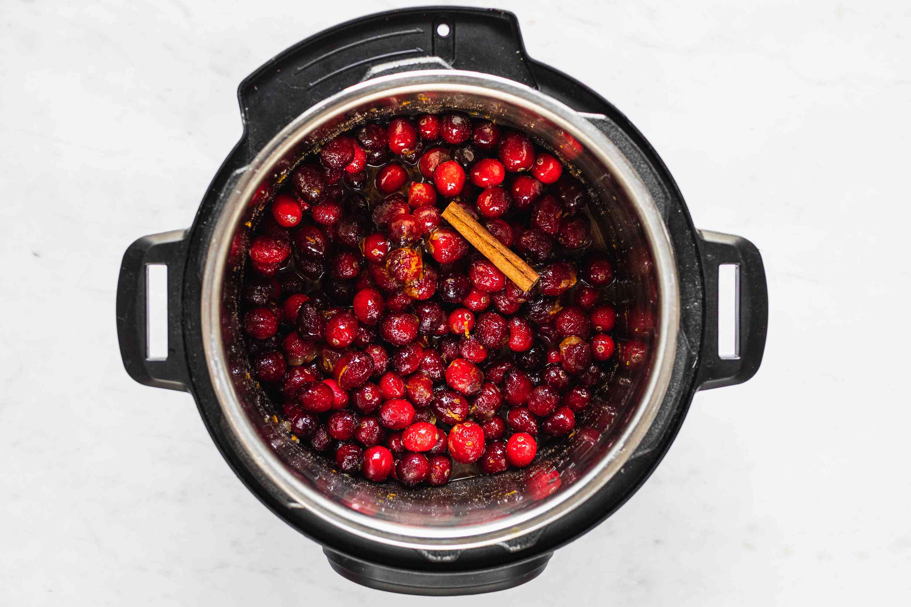 sugar, orange juice, maple syrup, finely grated orange zest, vanilla extract, and the cinnamon in an instant pot with cranberries