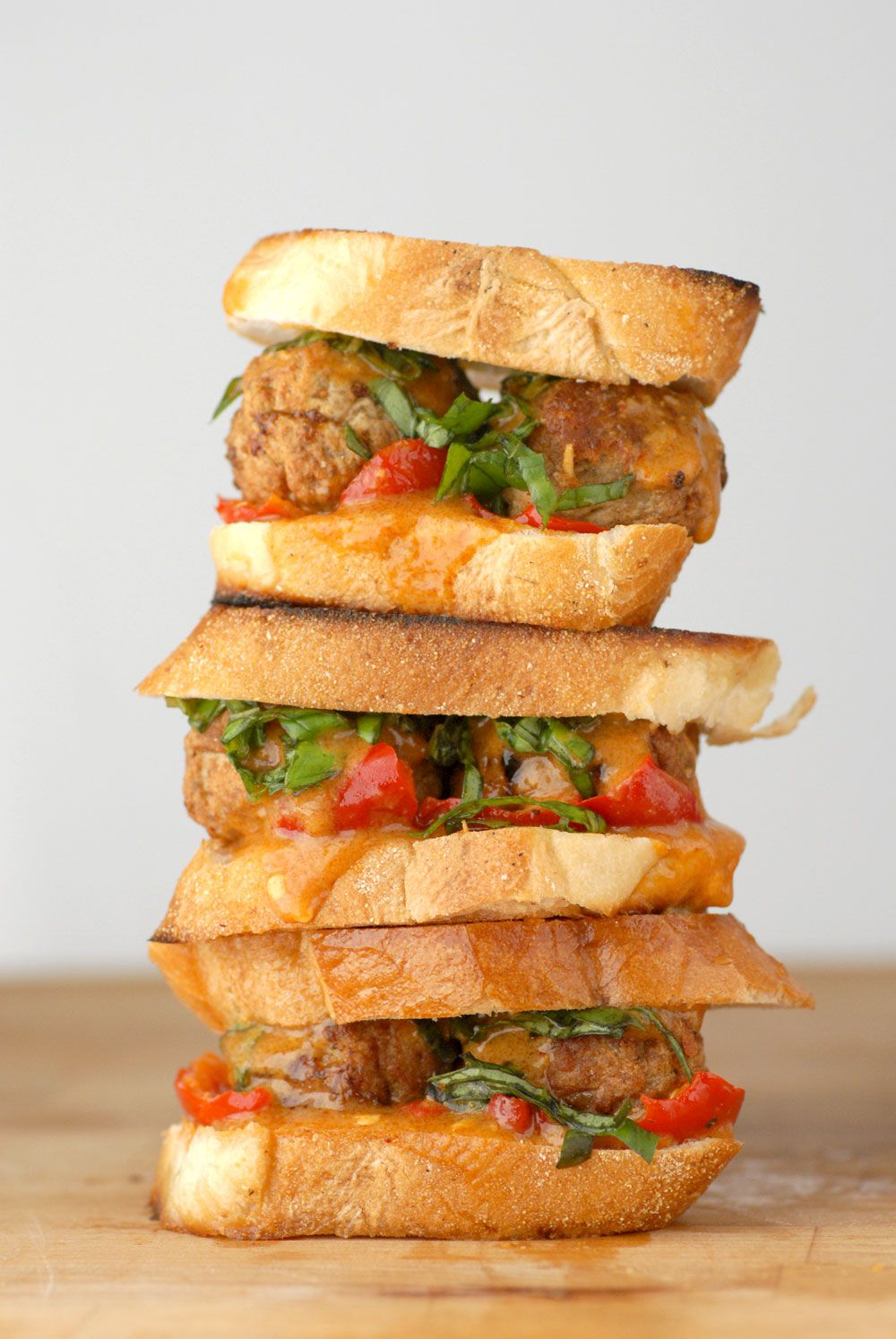 Curried Meatball Sliders With Cherry Peppers and Thai Basil