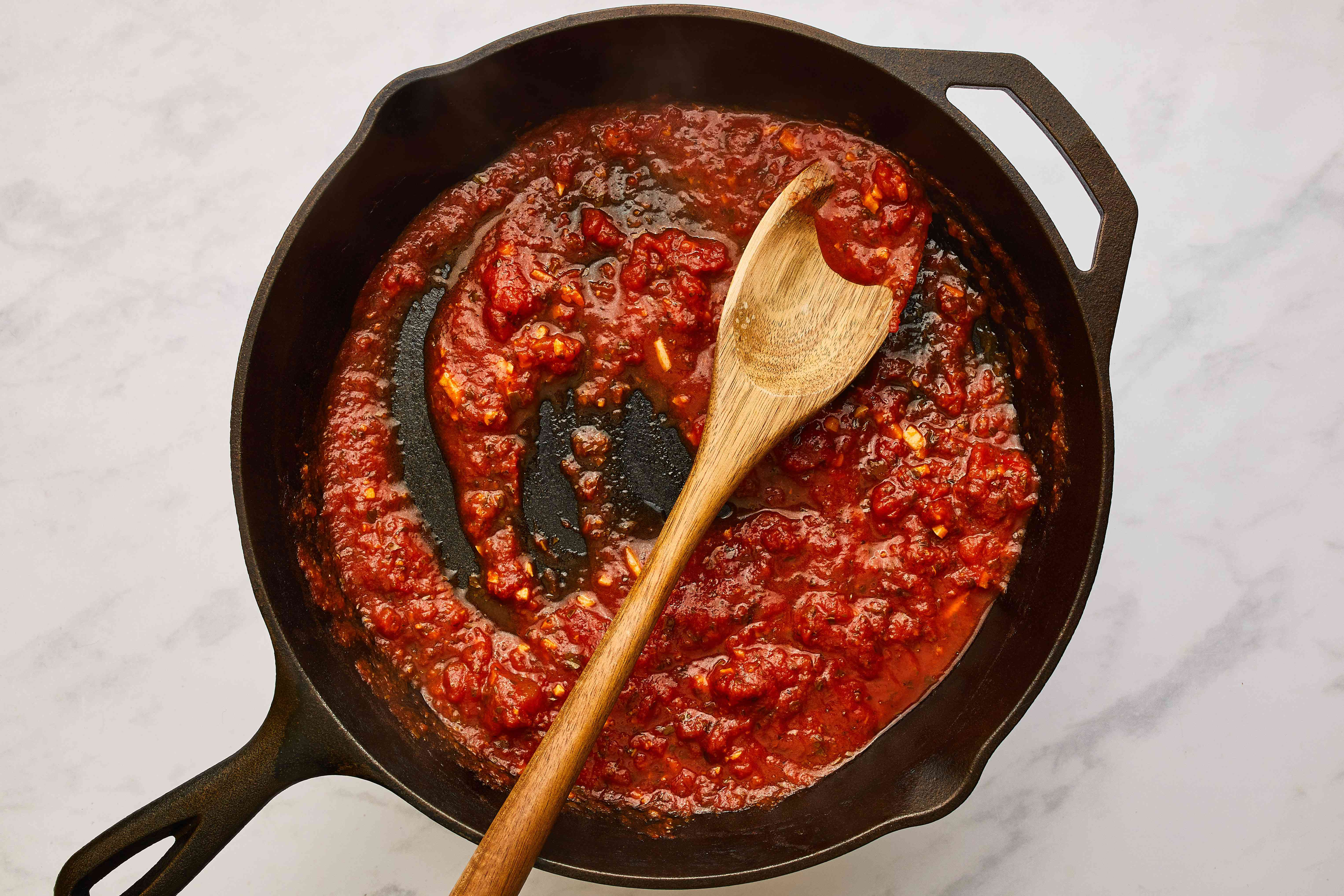 Heat the tomato sauce and garlic in a large saucepan
